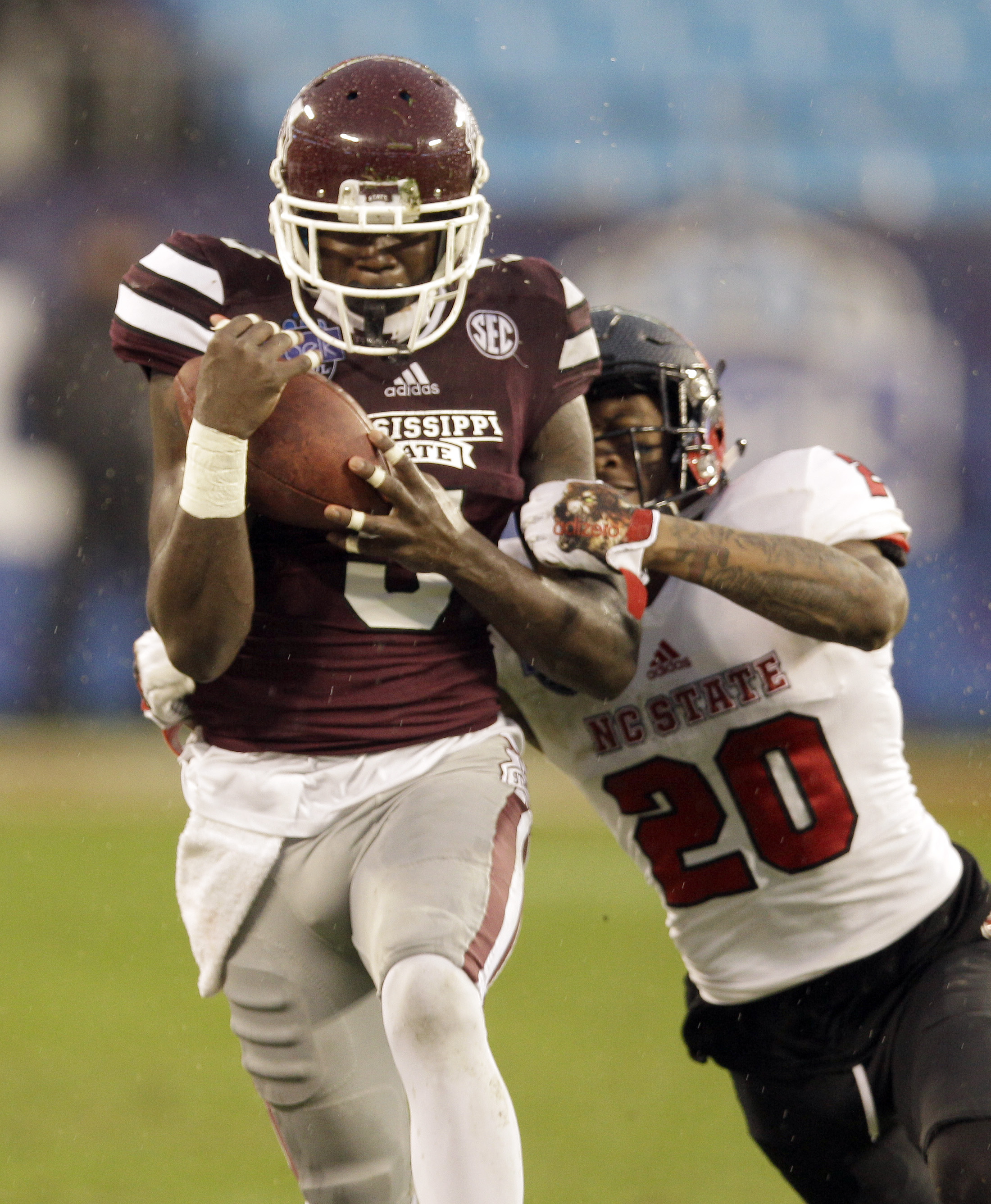 Mississippi State wide receiver Fred Brown (5) catches a pass as North Carolina State cornerback Mike Stevens (20) defends in the first half of the Belk Bowl NCAA college football game in Charlotte, N.C., Wednesday, Dec. 30, 2015. (AP Photo/Nell Redmond)