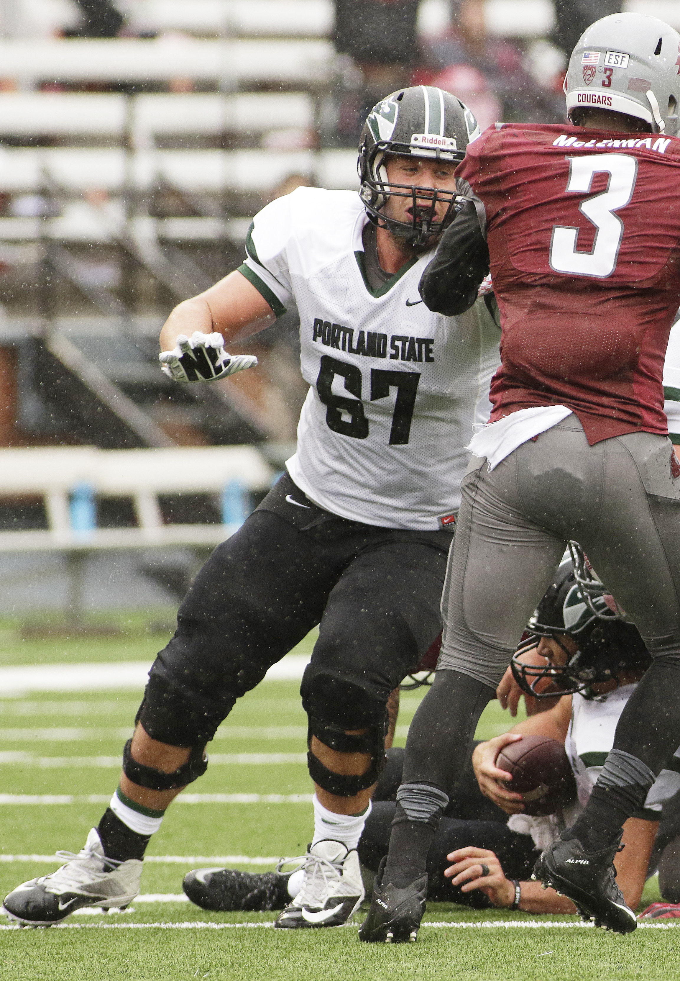 Portland State offensive lineman Kyle Smith (67) blocks Washington State linebacker Ivan McLennan (3) during a play during the second half of an NCAA college football game against Washington State, Saturday, Sept. 5, 2015, in Pullman, Wash. (AP Photo/Youn