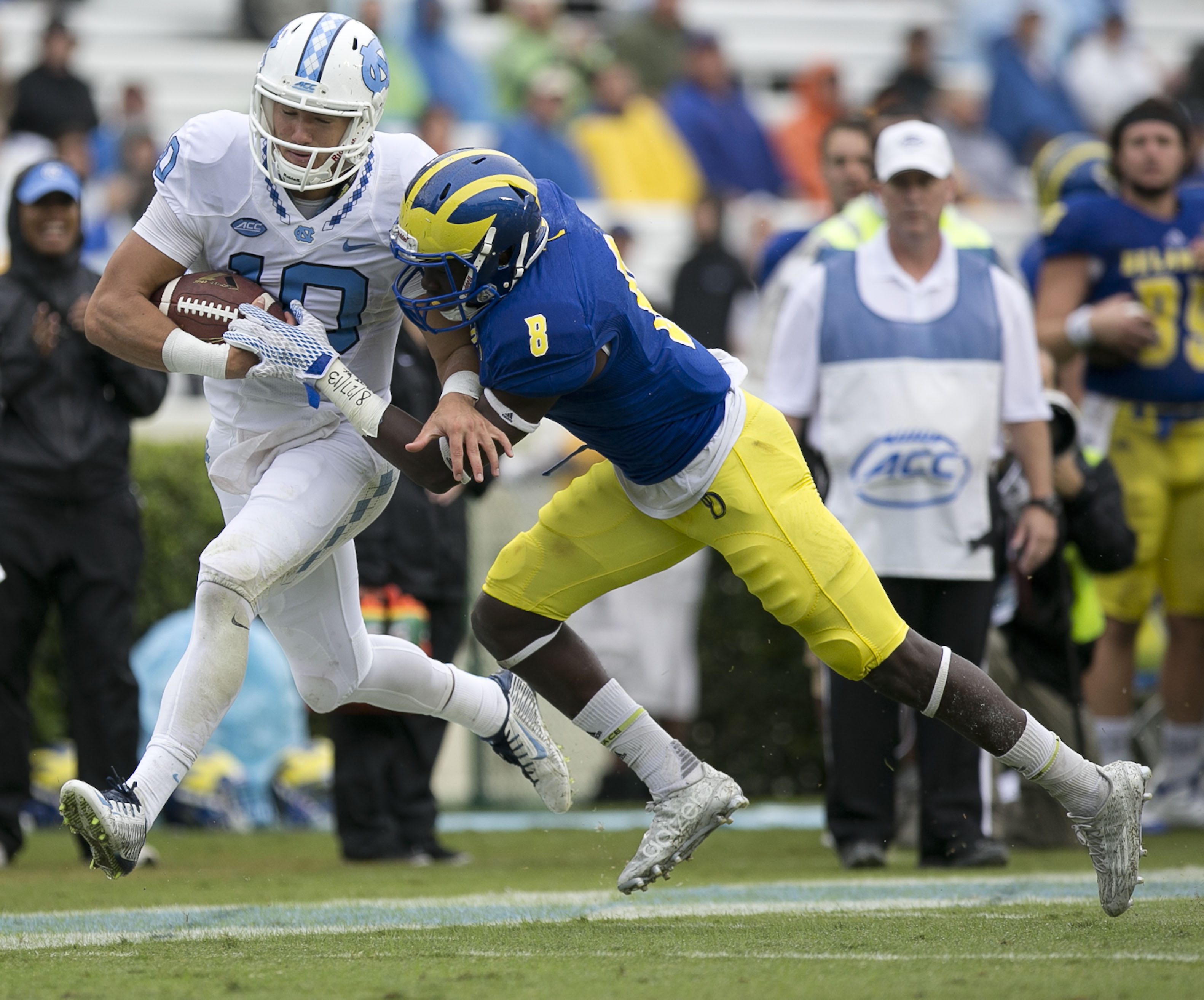 FILE - In this Sept. 26, 2015 file photo, North Carolina quarterback Mitch Trubisky (10) picks up yardage before being stopped by Delawares Tenny Adewusi (8) in the fourth quarter of an NCAA college football game in Chapel Hill, N.C. Mitch Trubisky has wa