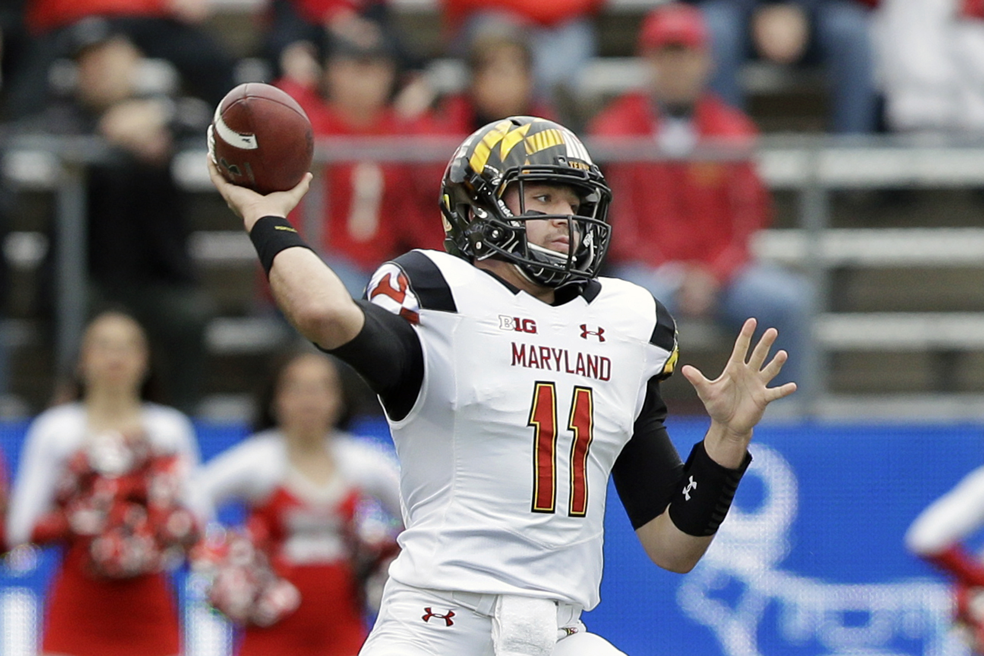 FILE - In this Nov. 28, 2015, file photo, Maryland quarterback Perry Hills (11) throws a pass during the first half of an NCAA college football game against Rutgers in Piscataway, N.J. Hills and Caleb Rowe are competing for the starting job under first-ye
