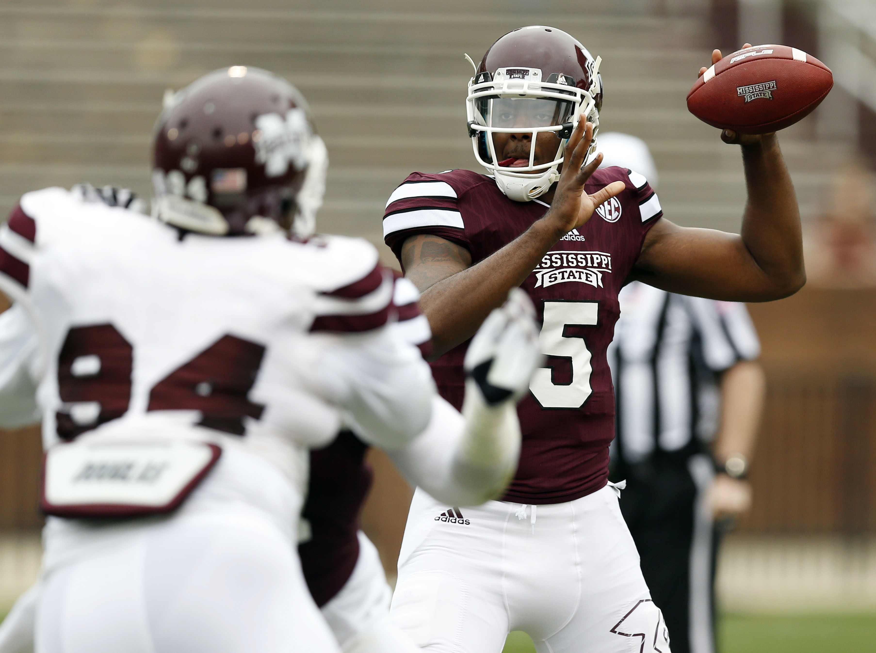 Mississippi State Maroon squad quarterback Elijah Staley (5) sets up to pass against the White squad during the second half of a spring NCAA college football game, Saturday, April 16, 2015, in Starkville, Miss. Maroon won 34-21. (AP Photo/Rogelio V. Solis