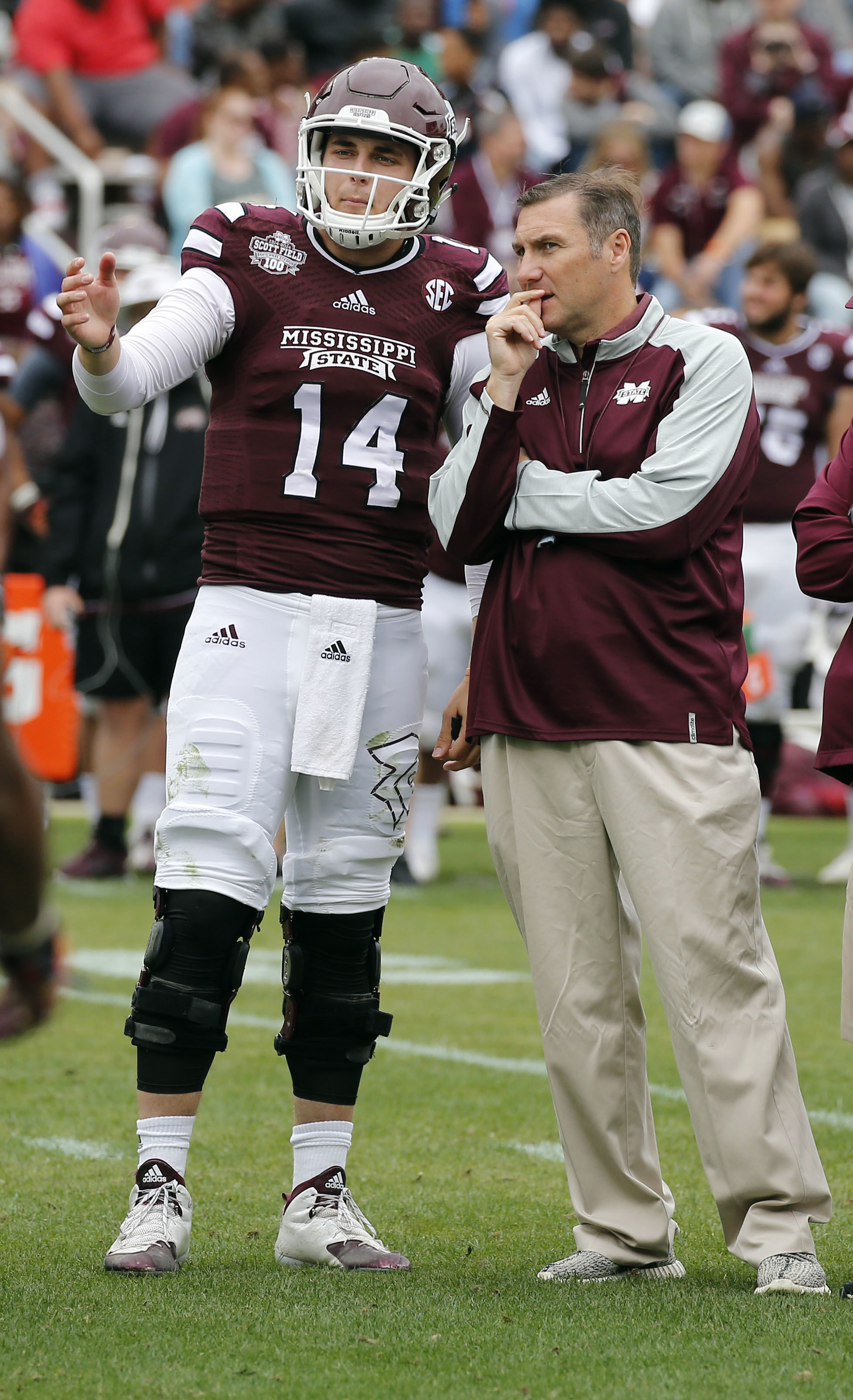 Mississippi State Maroon squad quarterback Nick Tiano (14) confers with coach Dan Mullen during the second half of a spring NCAA college football game, Saturday, April 16, 2015, in Starkville, Miss. Maroon won 34-21. (AP Photo/Rogelio V. Solis)