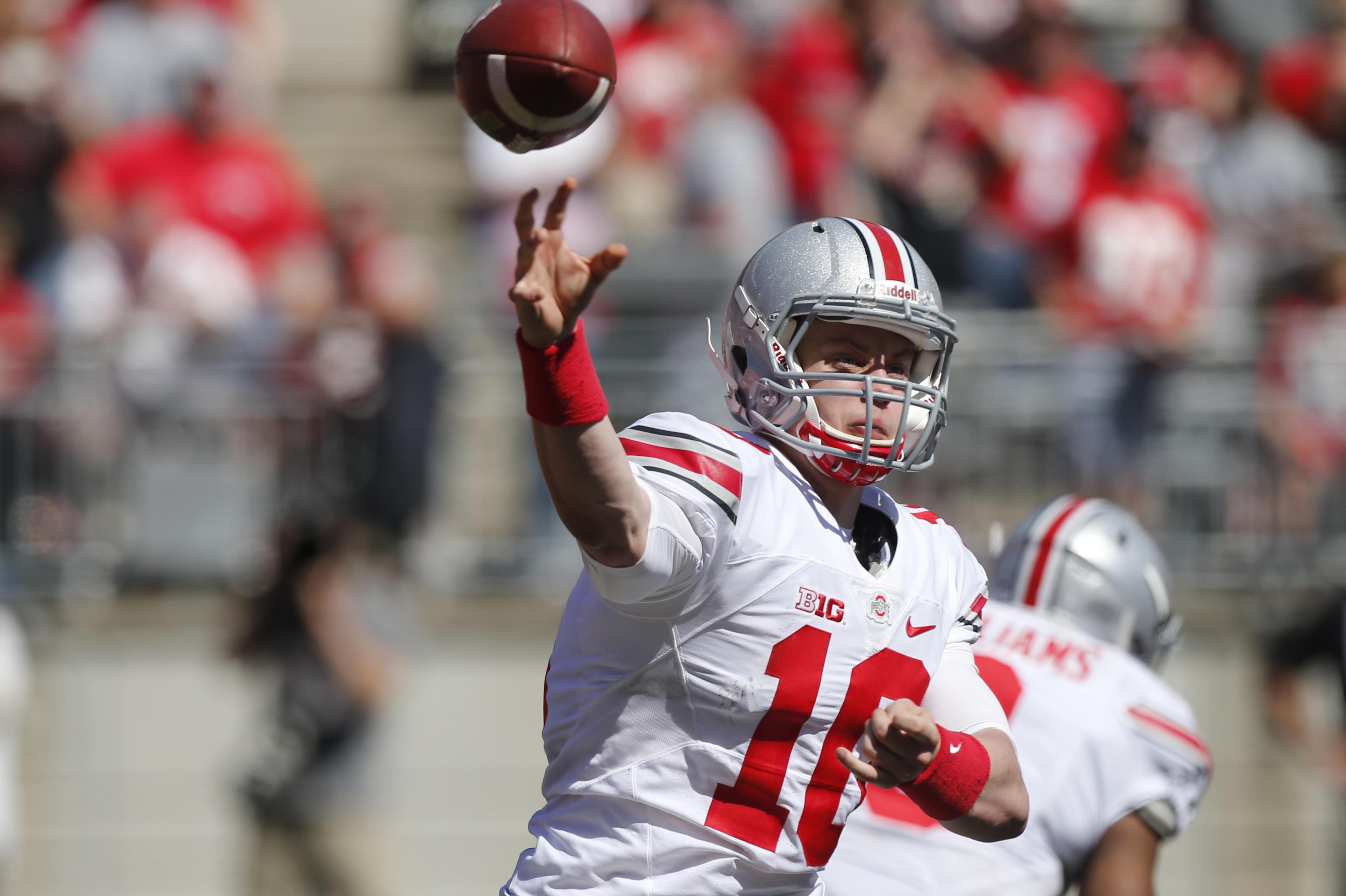 Ohio State quarterback Joe Burrow throws a pass during Ohio State's NCAA college football spring game Saturday, April 16, 2016, in Columbus, Ohio. (AP Photo/Jay LaPrete)