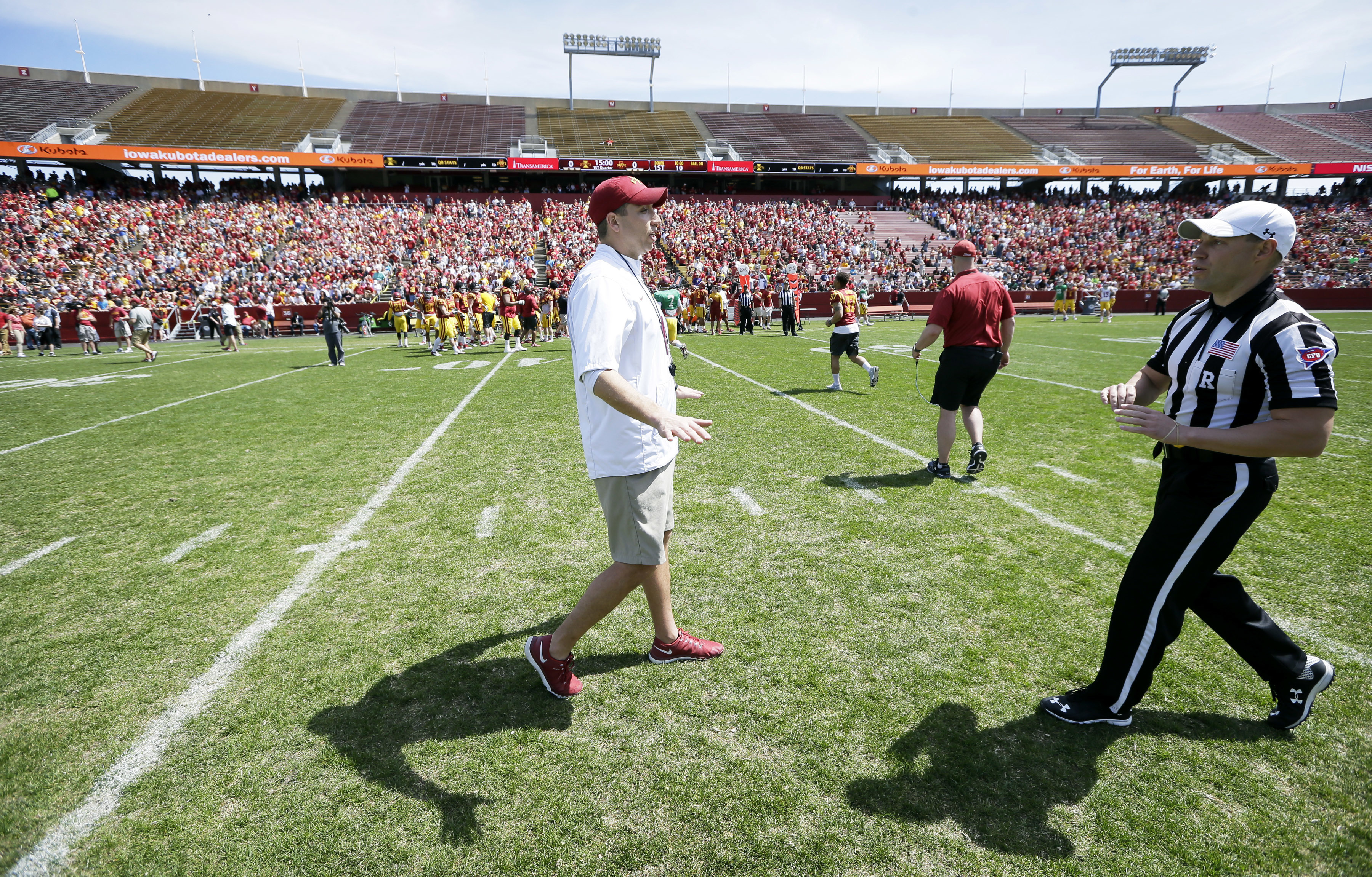 Iowa State head coach Matt Campbell, left, talks with an official before his team's spring NCAA college football game, Saturday, April 16, 2016, in Ames, Iowa. (AP Photo/Charlie Neibergall)
