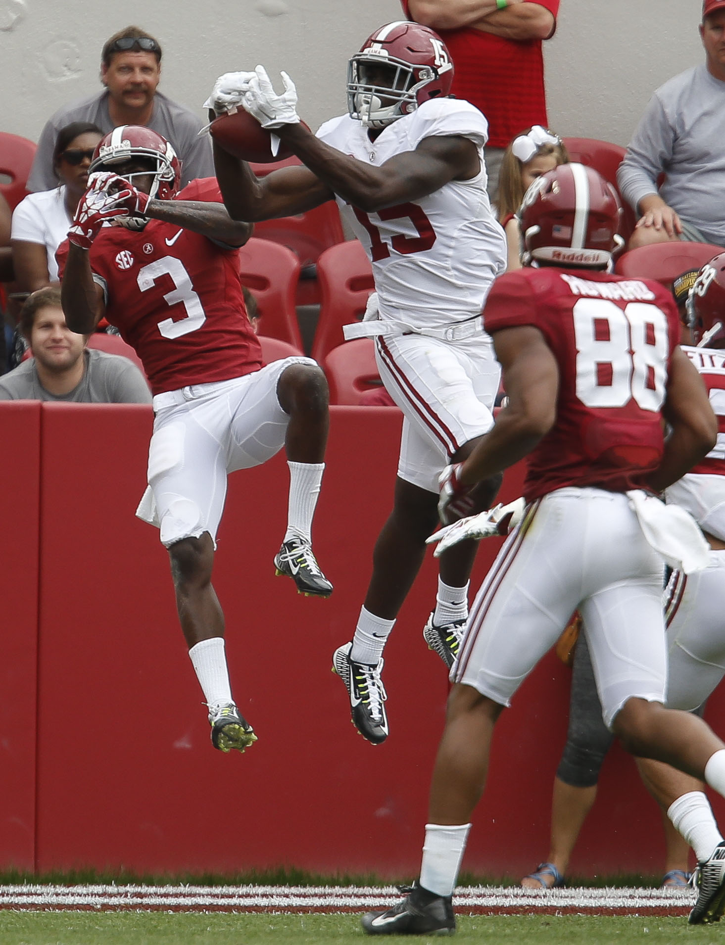 Alabama defensive back Ronnie Harrison picks off a pass in the end zone intended for wide receiver Calvin Ridley during an NCAA college spring football game, Saturday, April 16, 2016 at Bryant-Denny Stadium in Tuscaloosa, Ala. (Gary Cosby Jr./The Tuscaloo