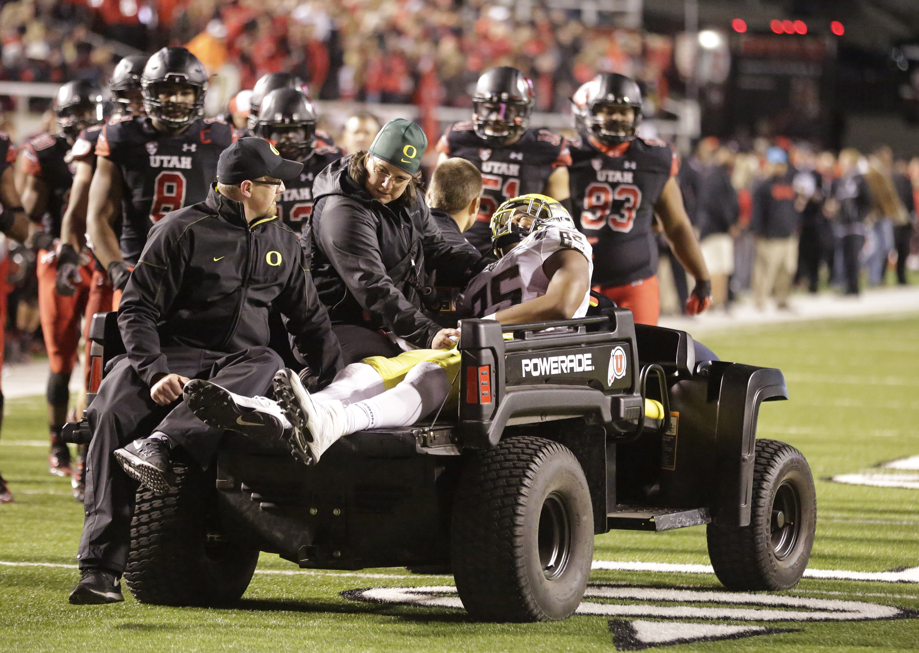 FILE - In this Saturday, Nov. 8, 2014 file photo, Oregon tight end Pharaoh Brown (85) is taken from the field after being injured in the fourth quarter during an NCAA college football game against Utah in Salt Lake City. Oregon tight end Pharaoh Brown ste