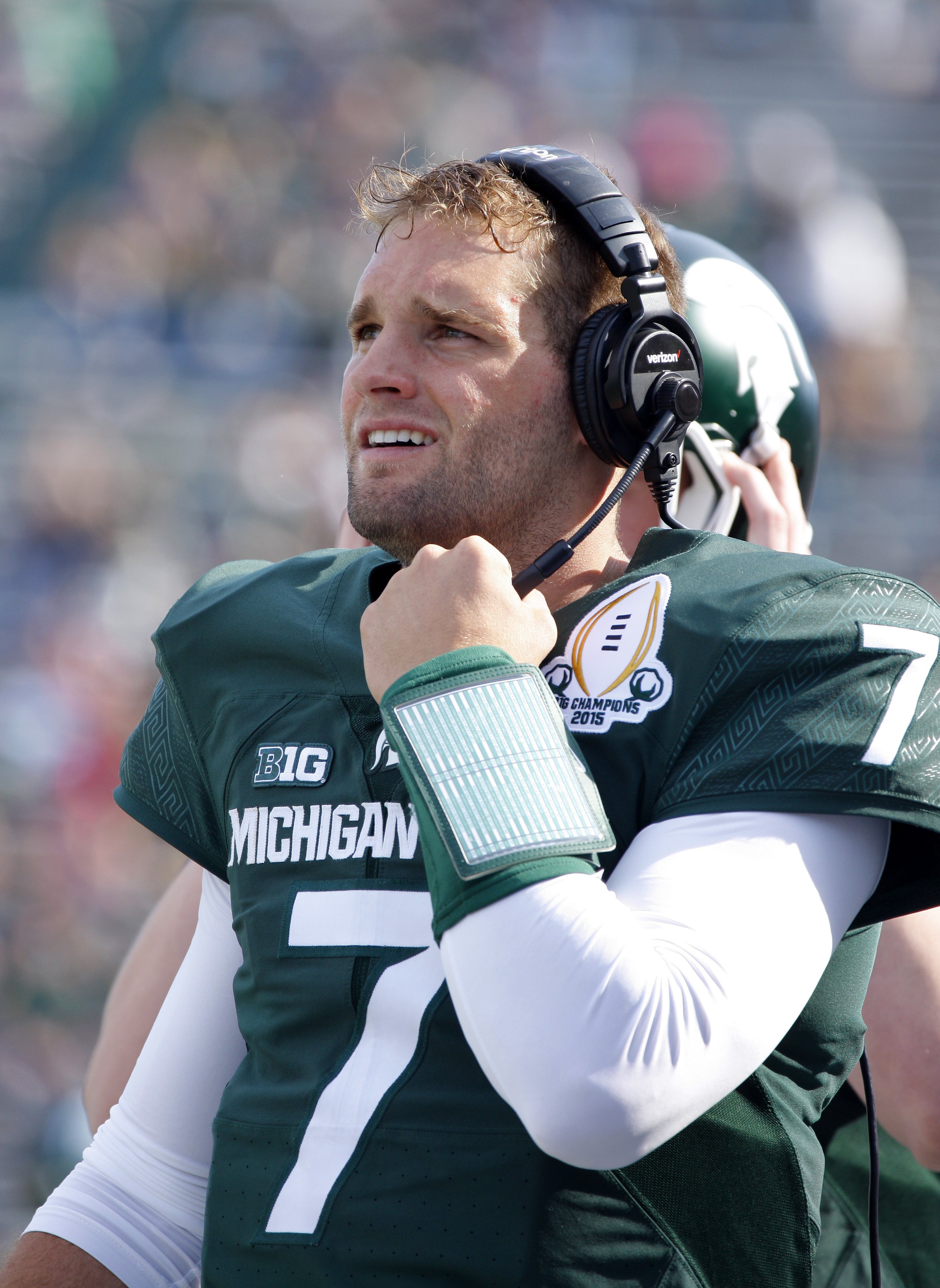 Michigan State green team quarterback Tyler O'Connor talks on a headset from the bench during the second half of an NCAA college football scrimmage, Saturday, April 23, 2016, in East Lansing, Mich. The white team won 14-11. (AP Photo/Al Goldis)