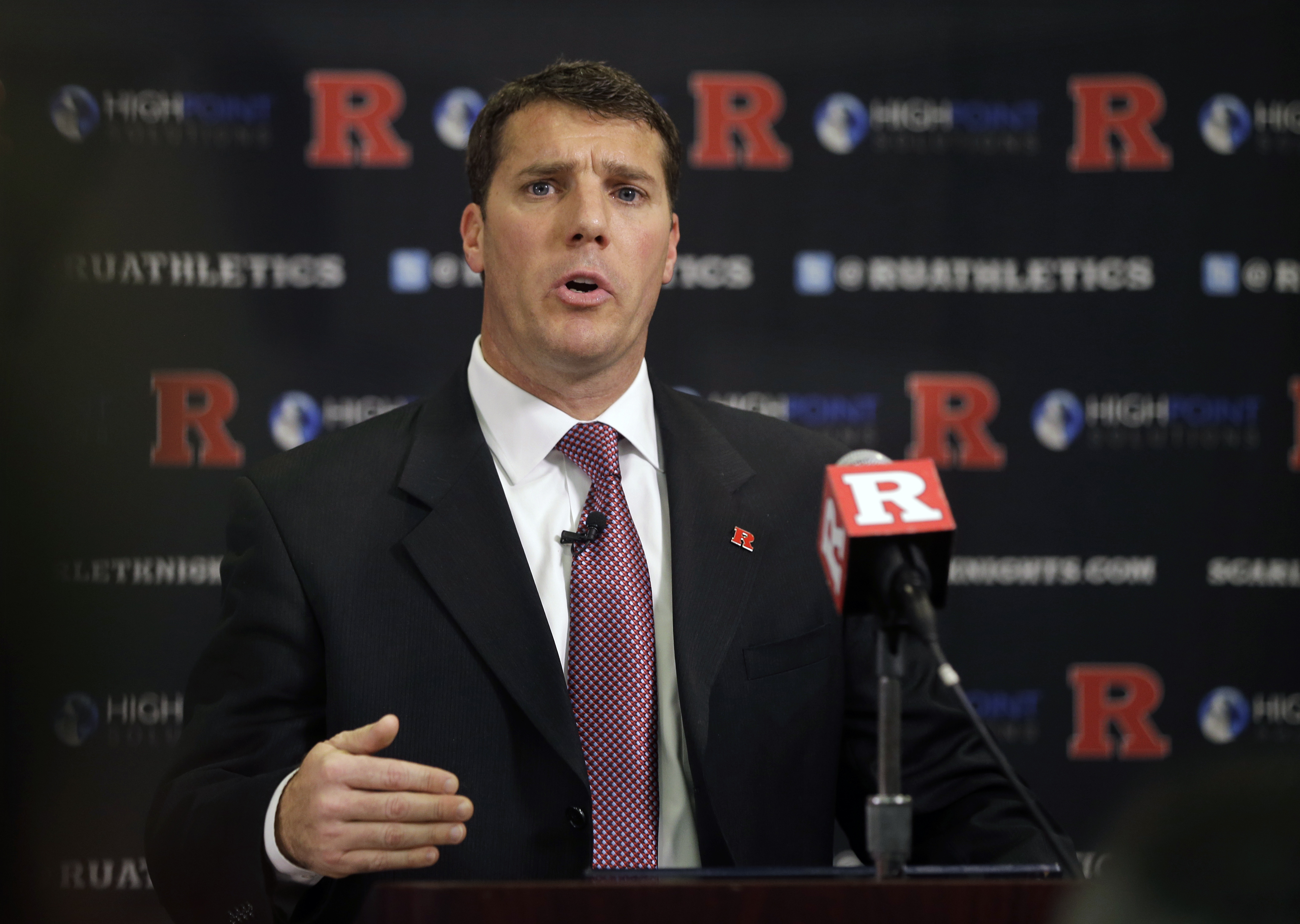 Chris Ash addresses a gathering after he was announced new NCAA college football coach for Rutgers,  Monday, Dec. 7, 2015, in Piscataway, N.J. Athletic director Julie Hermann and football coach Kyle Flood were fired Sunday, Nov. 29, 2015. (AP Photo/Mel Ev
