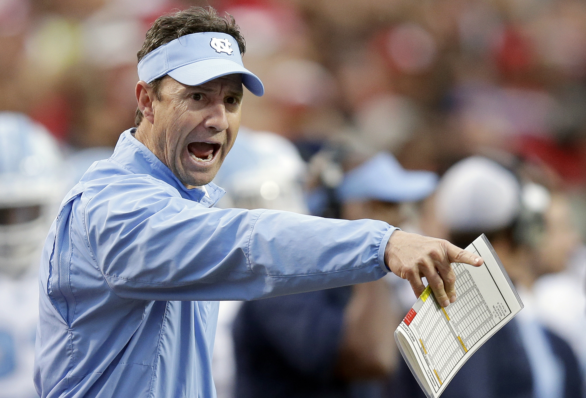 FILE - In this Nov. 28, 2015, file photo, North Carolina coach Larry Fedora yells at an official during the first half an NCAA college football game against North Carolina State in Raleigh, N.C. Fedora's team became the fifth different team in as many sea