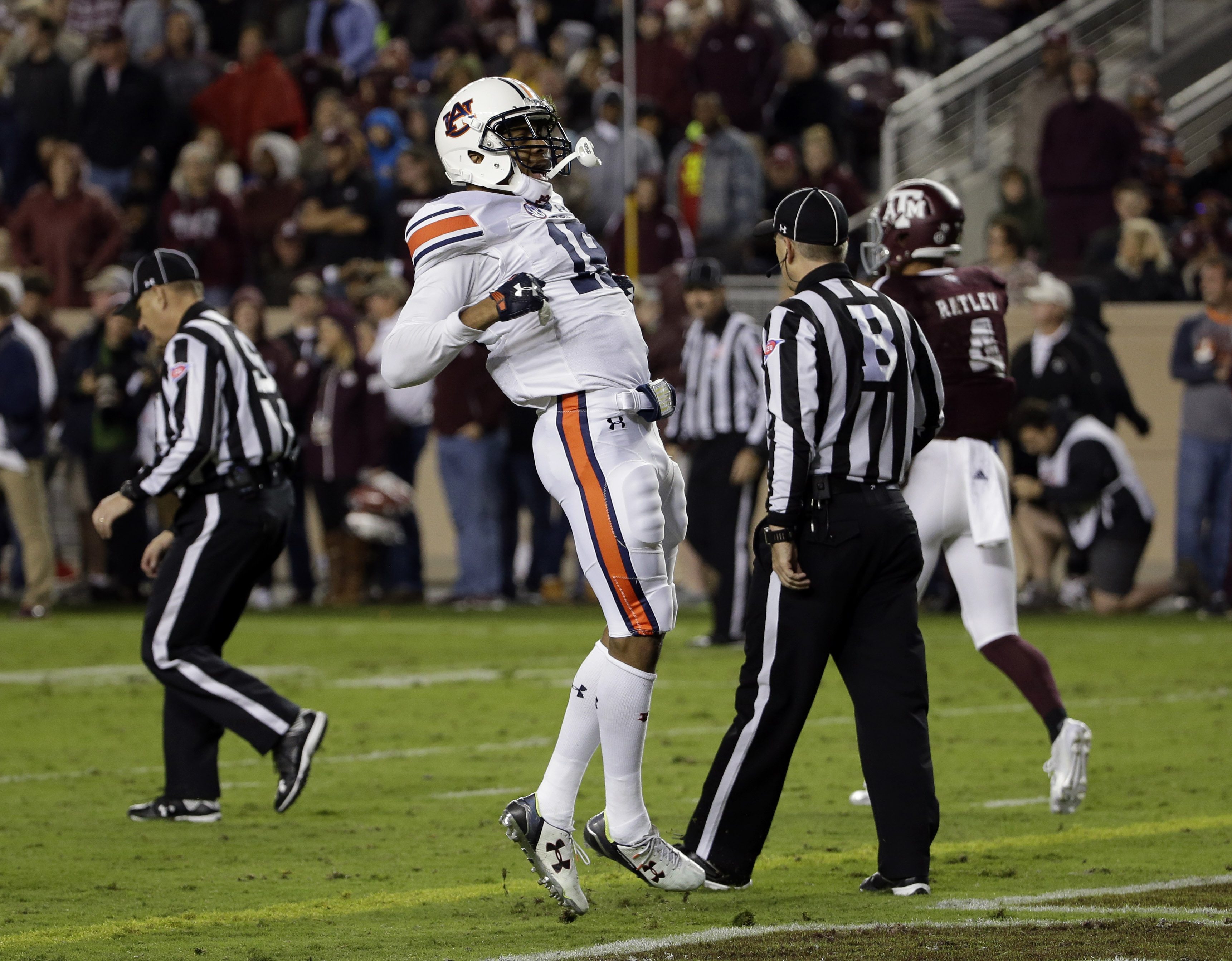 Auburn defensive back Carlton Davis celebrates after intercepting a pass in the end zone during the first quarter of an NCAA college football game against Texas A&M, Saturday, Nov. 7, 2015, in College Station, Texas. (AP Photo/David J. Phillip)
