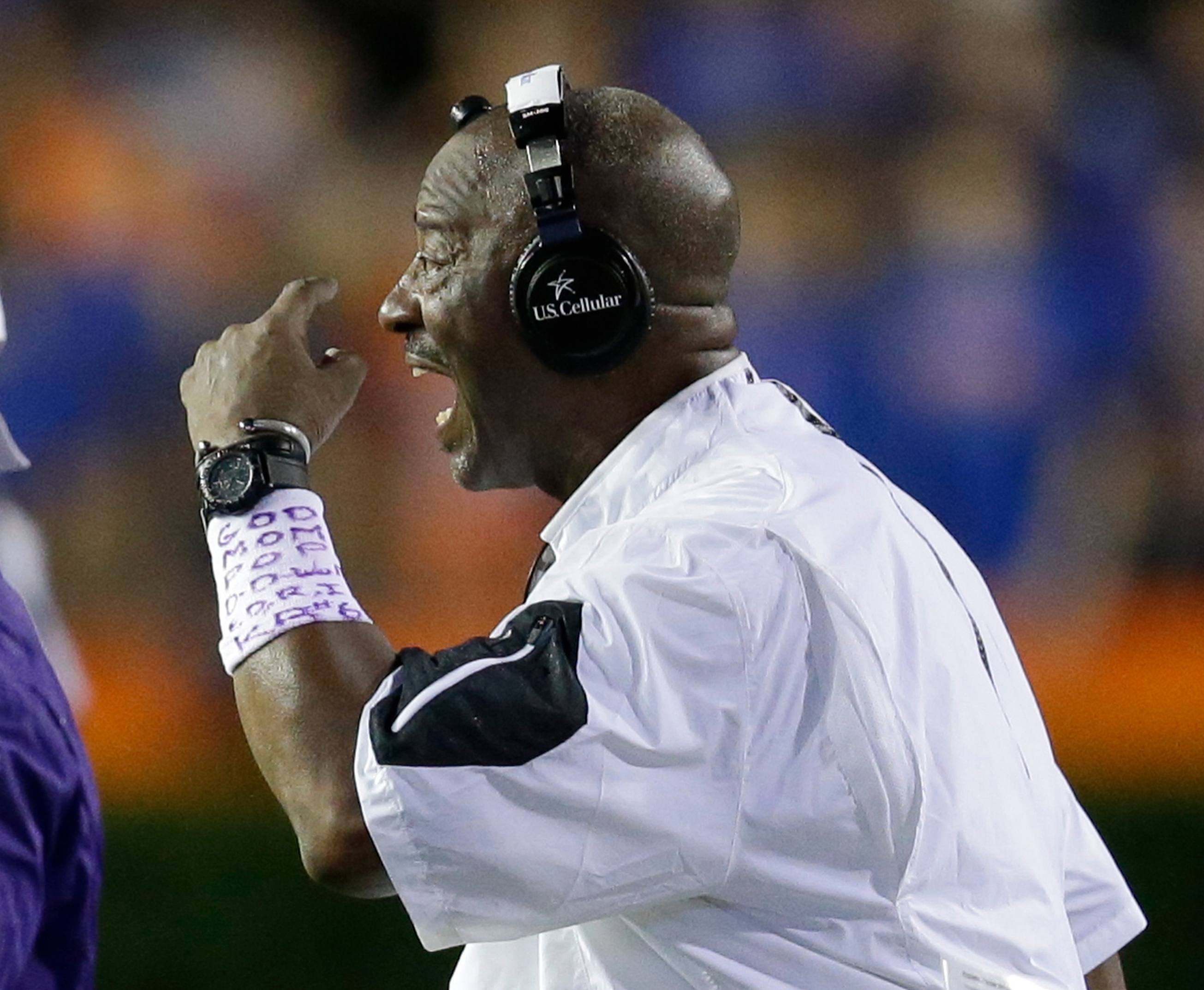 FILE - In this Sept. 12, 2015 file photo, East Carolina head coach Ruffin McNeill motions to his players during the second half of an NCAA college football game against Florida, in Gainesville, Fla. McNeill no longer commands the corner office where the h