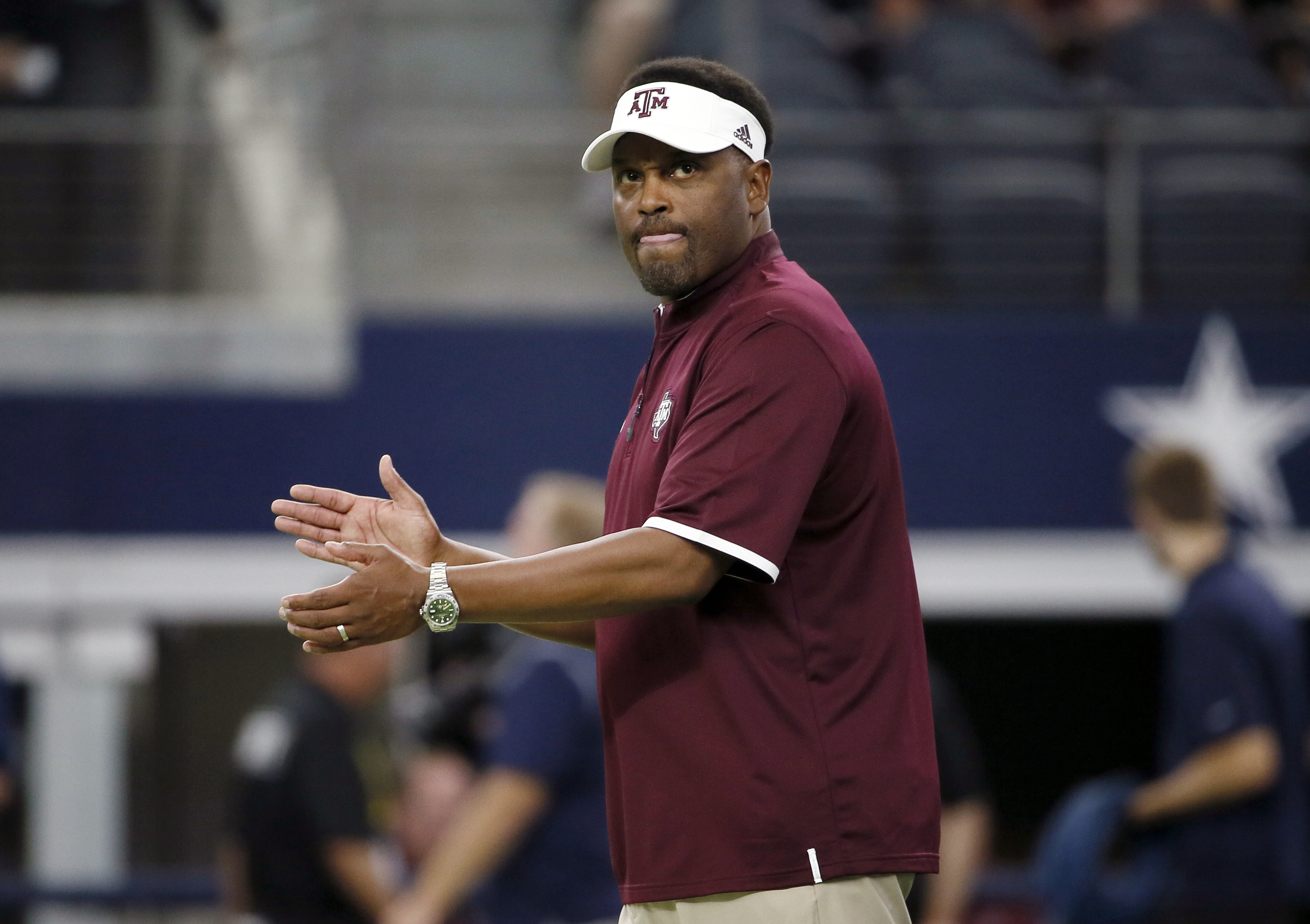 FILE - In this Sept. 26, 2015 file photo, Texas A&M coach Kevin Sumlin applauds his team as players warm up for an NCAA college football game against Arkansas, in Arlington, Texas. The Aggies have lost some of the swag that came when Johnny Football took