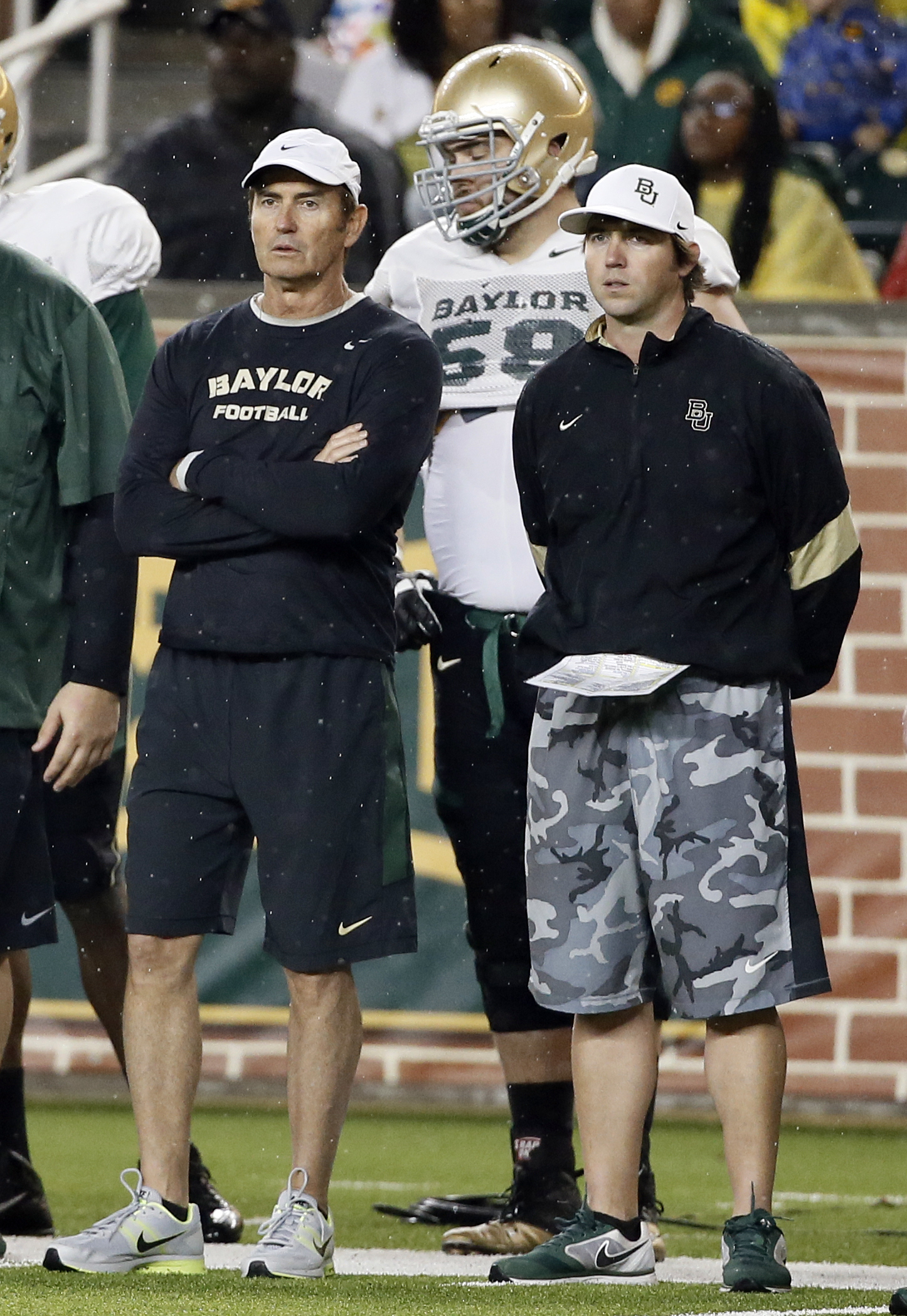 FILE - In this March 20, 2015, file photo, then-Baylor coach Art Briles, left, and offensive coordinator Kendal Briles, right, watch a play during the team's NCAA college football intrasquad scrimmage in Waco, Texas. Baylor has kept intact its assistant c
