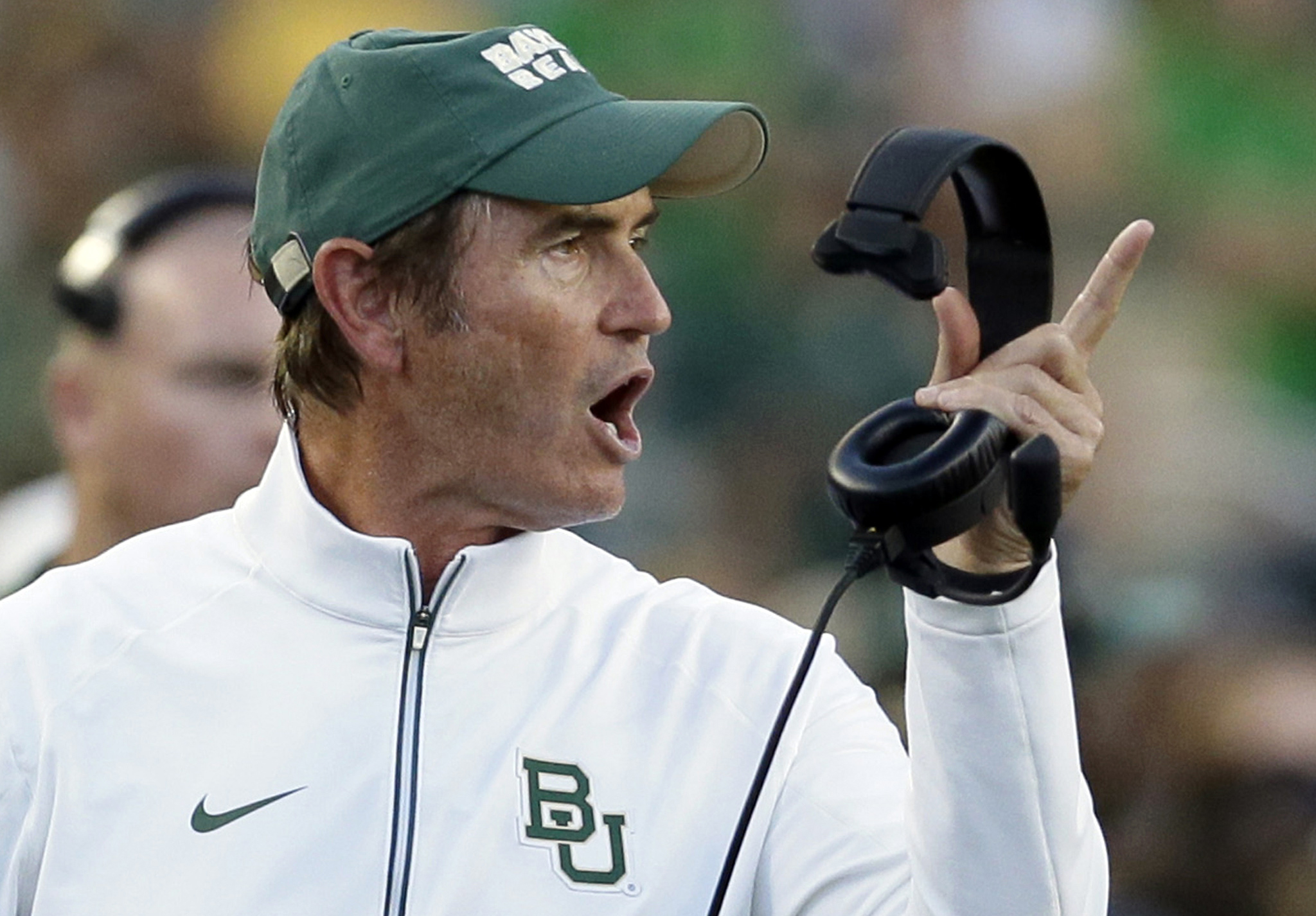 FILE - In this Sept. 12, 2015, file photo, Baylor coach Art Briles yells from the sideline during the first half of an NCAA college football game against Lamar in Waco, Texas. Briles is accusing Baylor of wrongful termination and indicating he has no inte