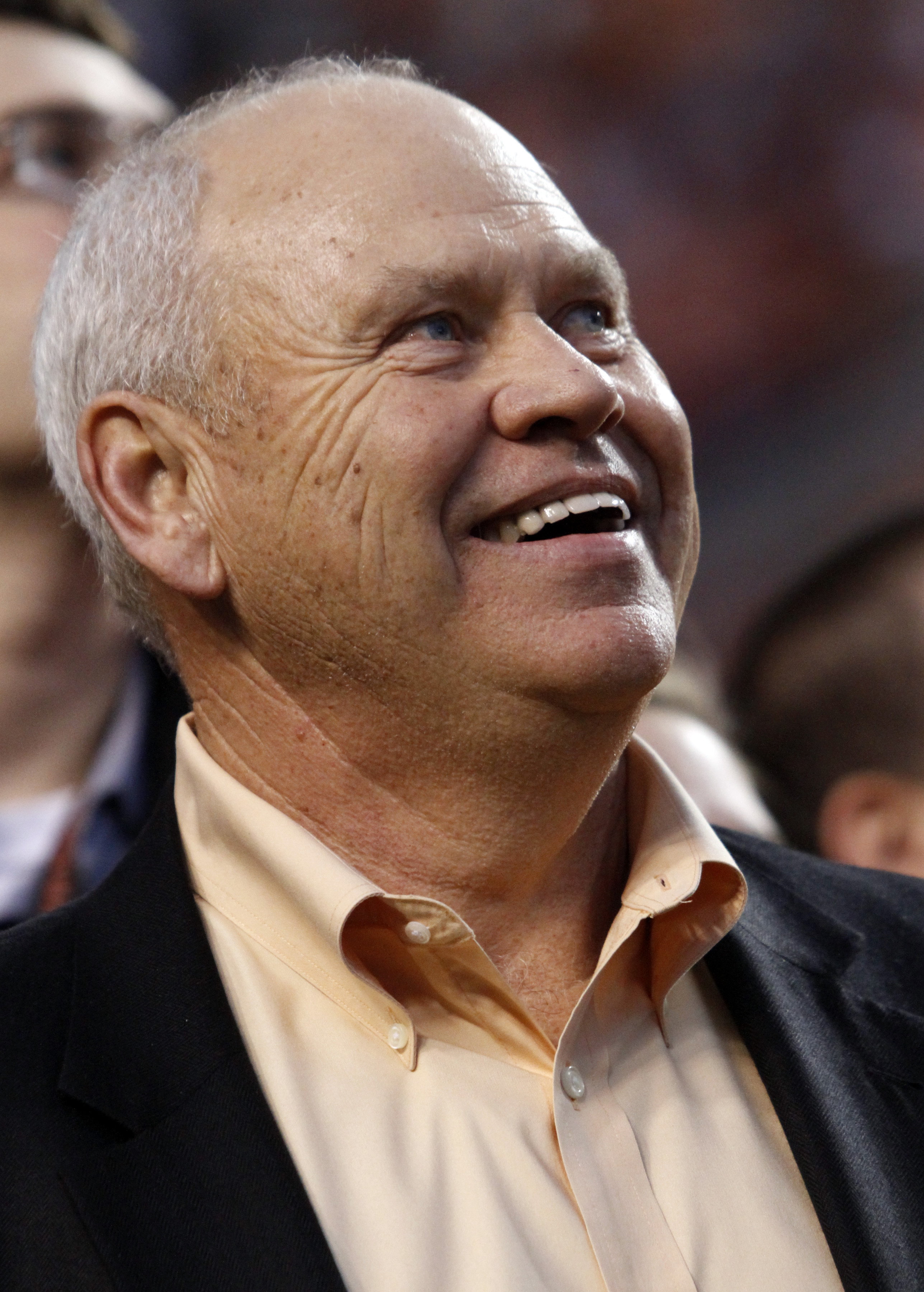 Former Tennessee head football coach Phillip Fulmer smiles as he watches the Jumbotron before the start of an NCAA college football game between Alabama and Tennessee, Saturday, Oct. 20, 2012, in Knoxville, Tenn. (AP Photo/Wade Payne)