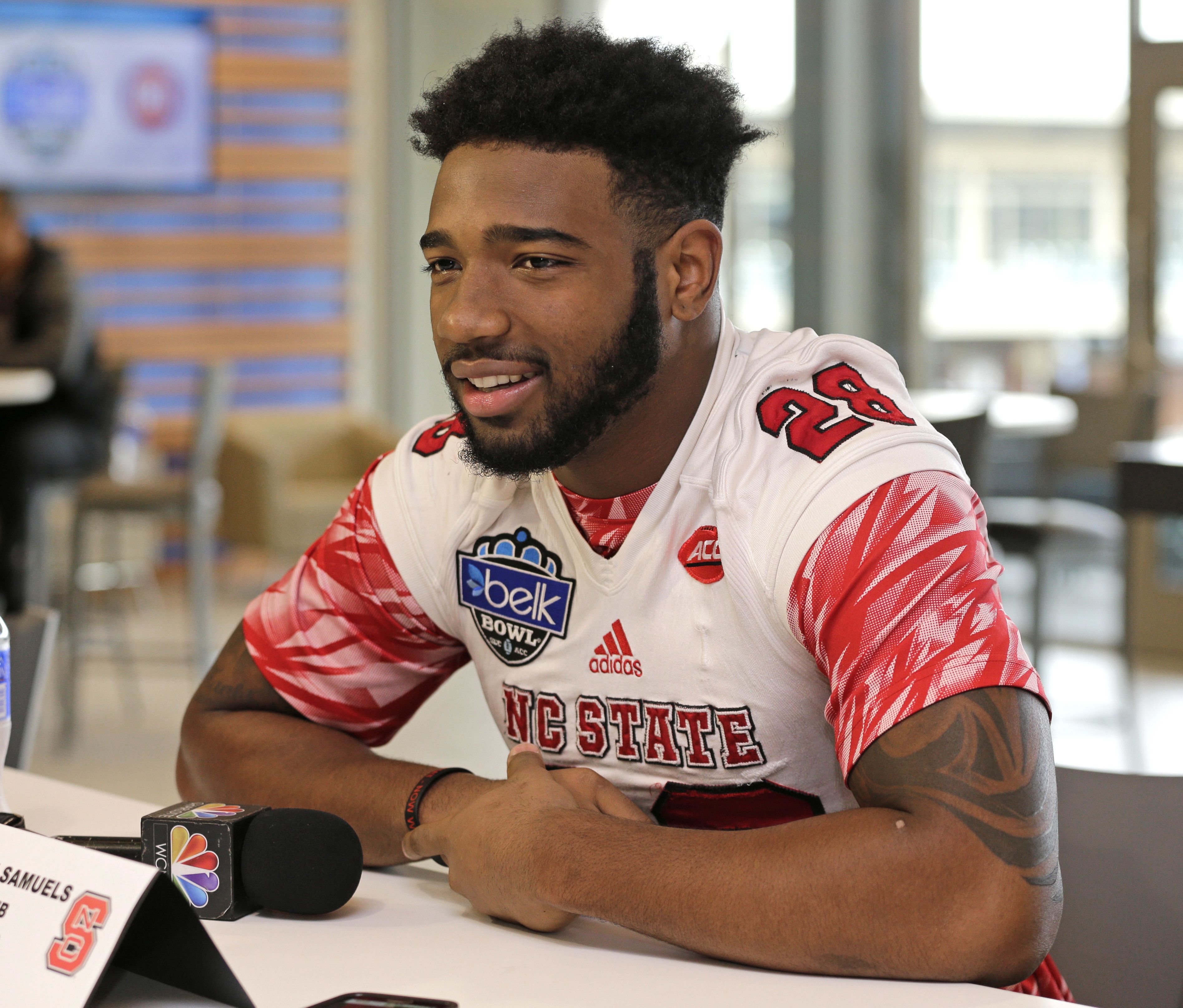 FILE - In this Tuesday, Dec. 29, 2015, file photo, North Carolina State's Jaylen Samuels speaks to the media during a news conference for the Belk Bowl NCAA college football game in Charlotte, N.C. Samuels had a combined 16 rushing and receiving touchdown