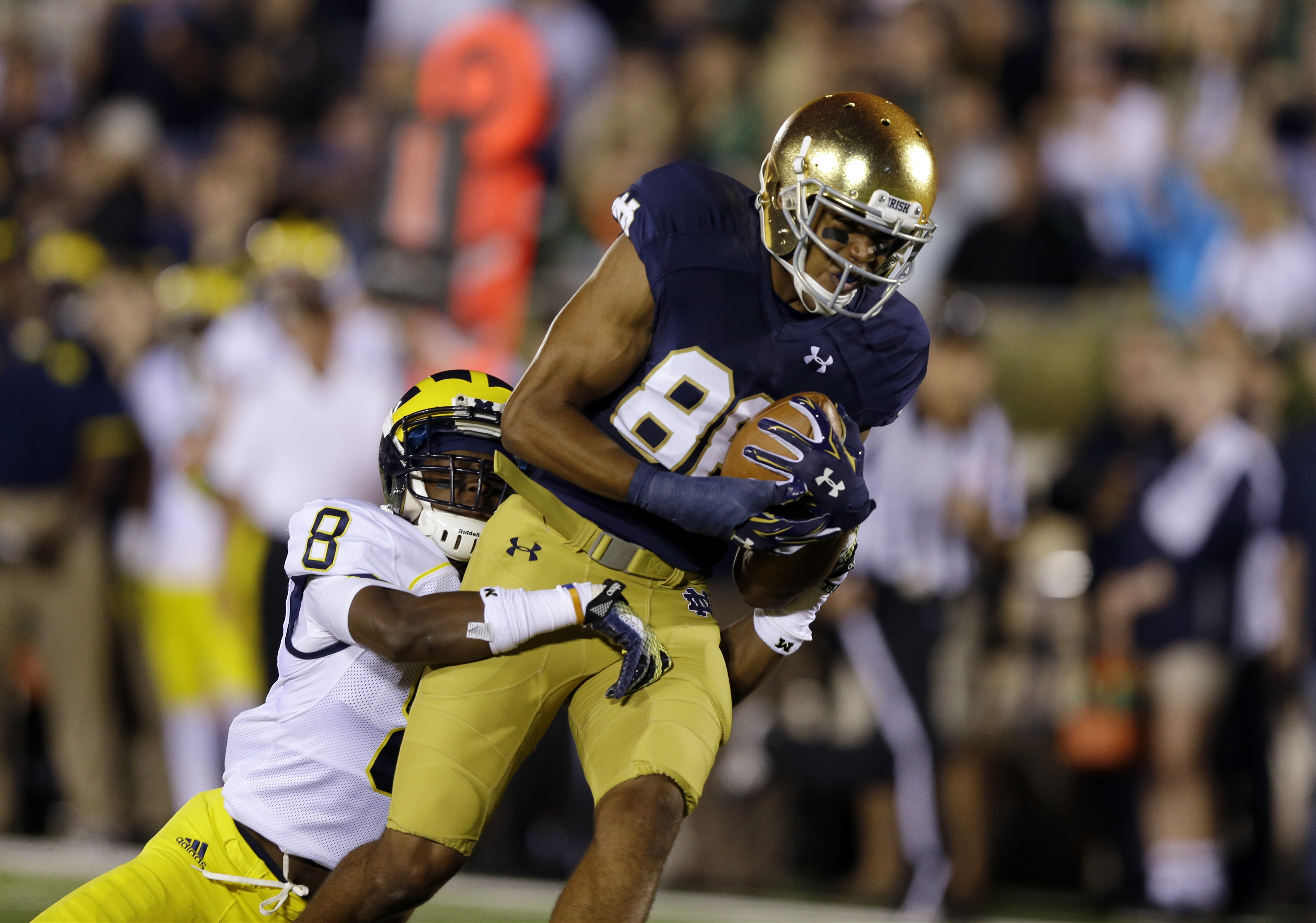 FILE - In this Sept. 6, 2014, file photo, Notre Dame wide receiver Corey Robinson, right, is tacked by Michigan defensive back Channing Stribling at the one-yard line during the first half of an NCAA college football game in South Bend, Ind. A person fami