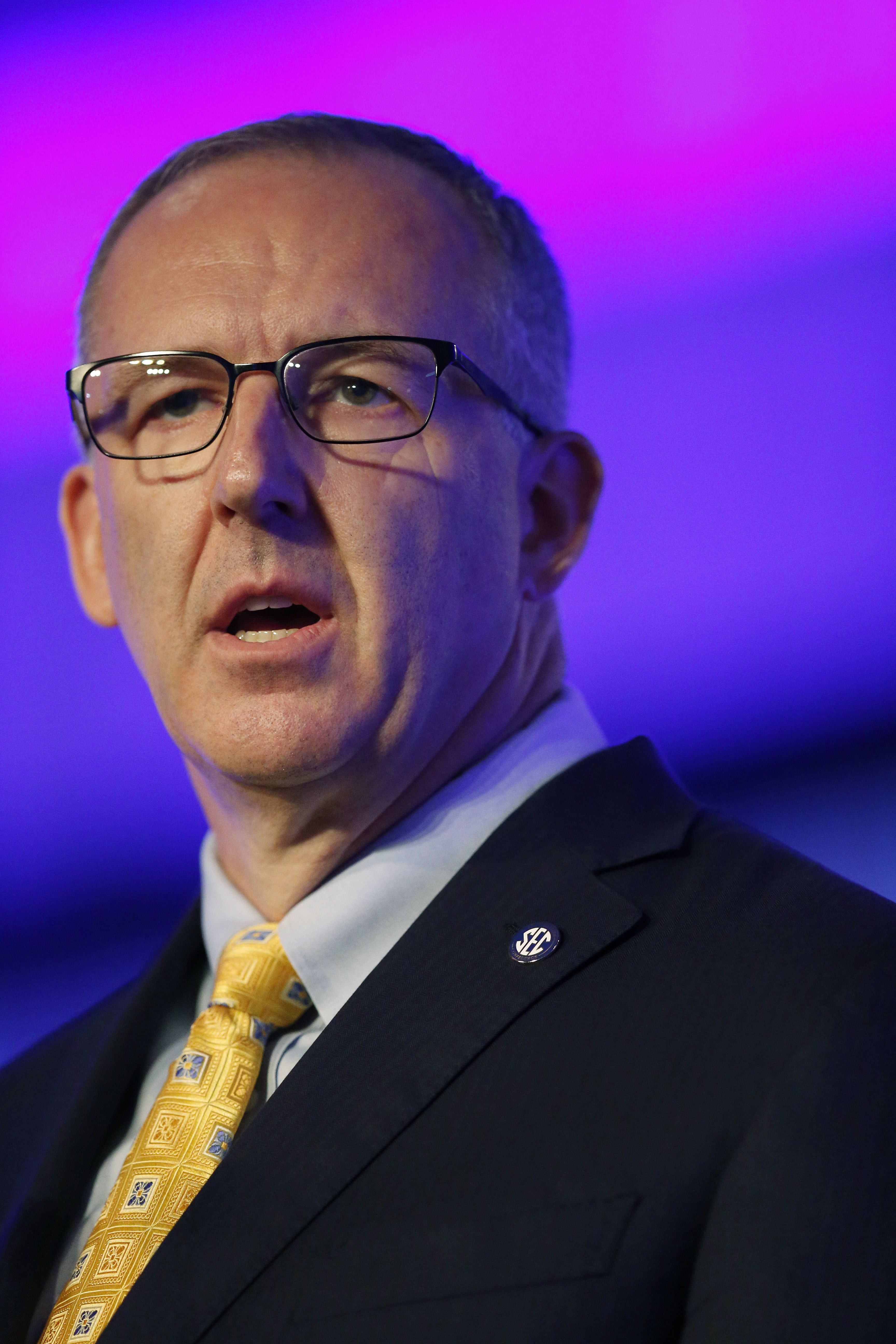 Southeastern Conference commissioner Greg Sankey speaks to the media at the Southeastern Conference NCAA college football media days, Monday, July 11, 2016, in Hoover, Ala. (AP Photo/Brynn Anderson)