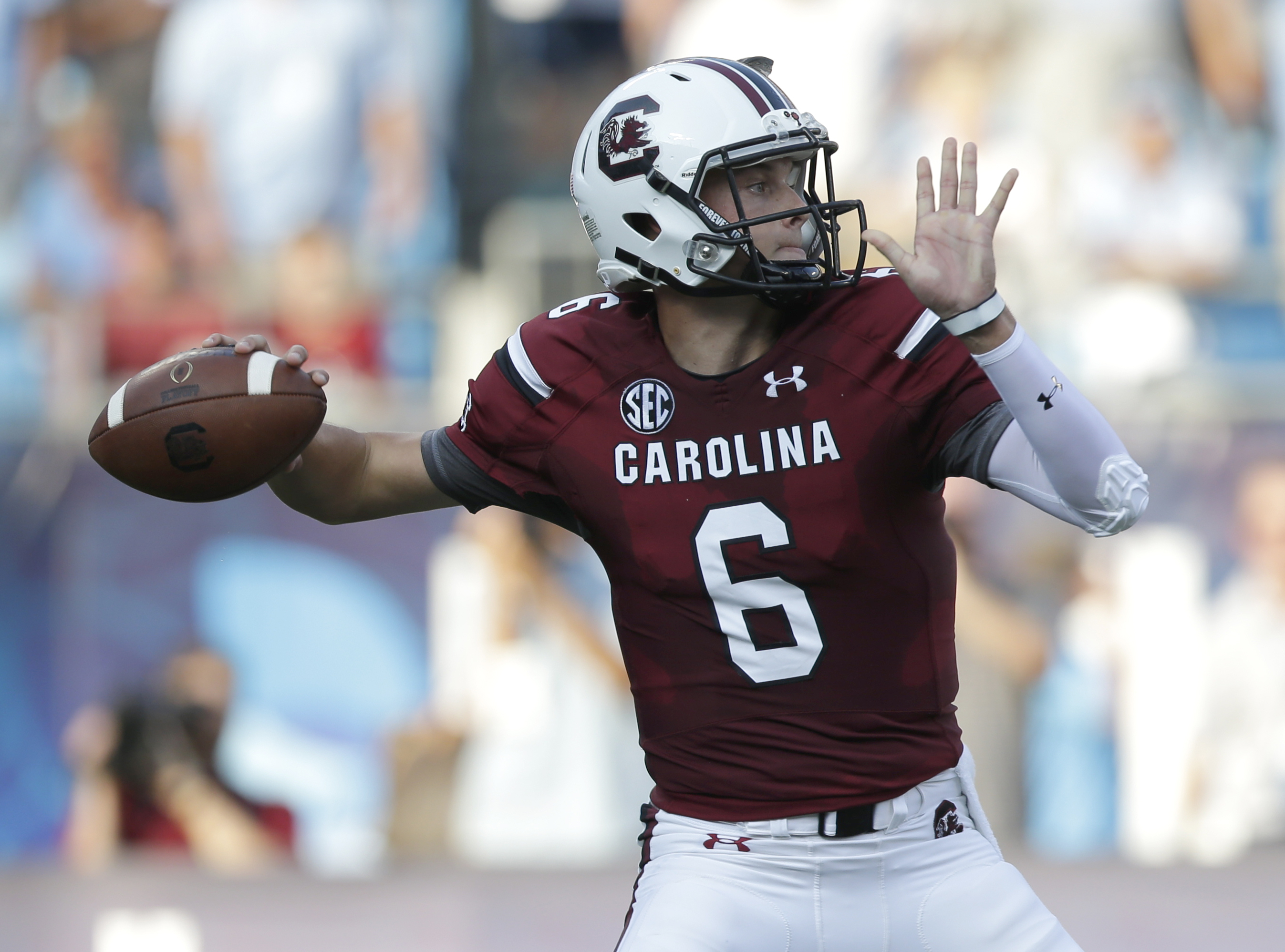 South Carolina's Connor Mitch looks to pass against North Carolina in the first half of an NCAA college football game in Charlotte, N.C., Thursday, Sept. 3, 2015. (AP Photo/Chuck Burton)
