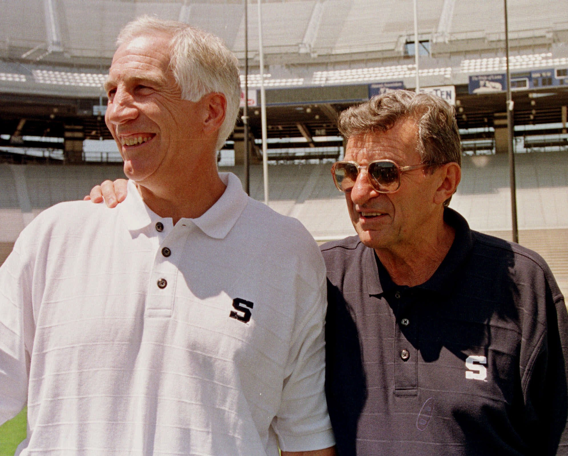 FILE - In this Aug. 6, 1999, file photo, Penn State head football coach Joe Paterno, right, poses with his defensive coordinator Jerry Sandusky during Penn State Media Day at State College, Pa. An amended complaint by the family and estate of Joe Paterno