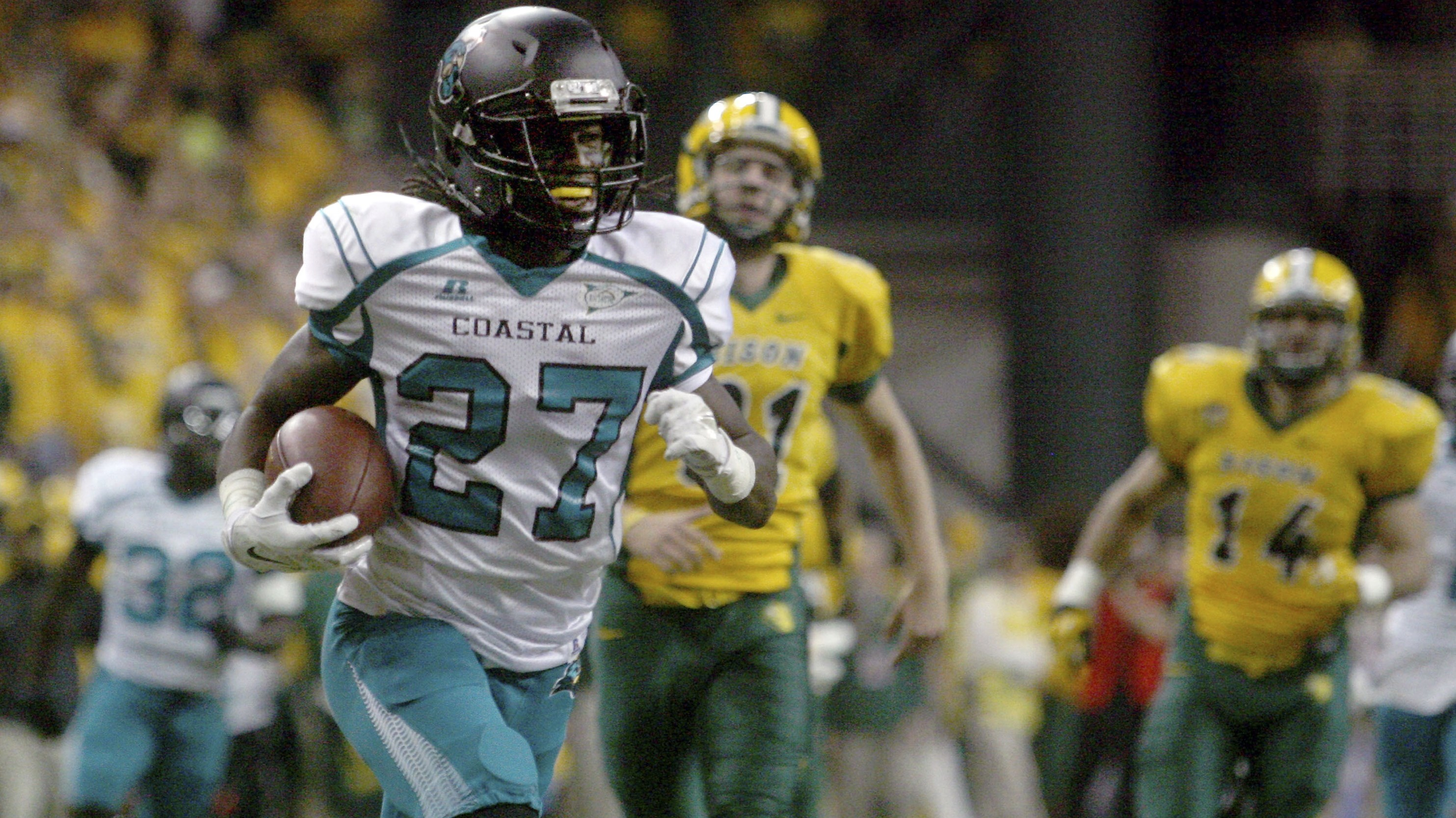 Coastal Carolina wide receiver Devin Brown outruns the North Dakota State defense for touchdown during during the first half of an FCS quarterfinal NCAA college football game Saturday, Dec. 13, 2014, in Fargo, N.D.  (AP Photo/Bruce Crummy)
