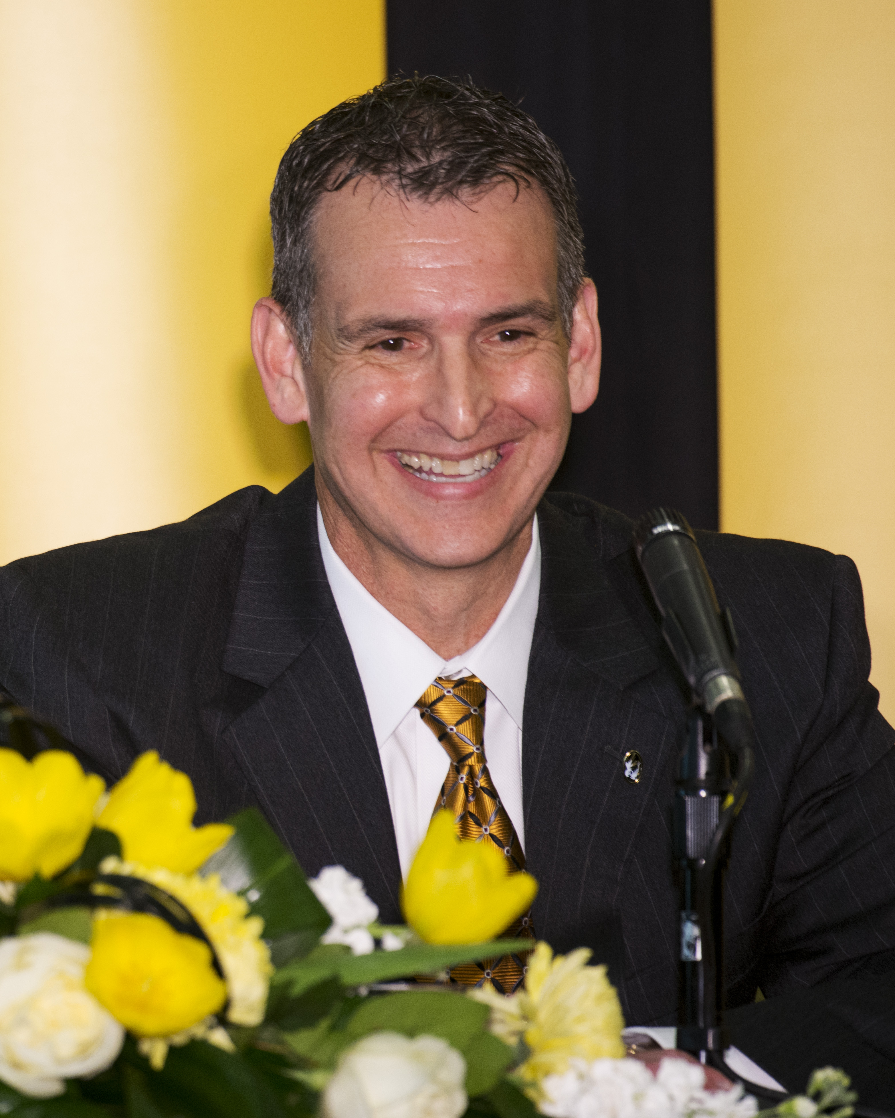Missouri athletic director Mack Rhoades smiles during his introductory press conference Tuesday, March 10, 2015, on the University of Missouri campus in Columbia, Mo. (AP Photo/L.G. Patterson)