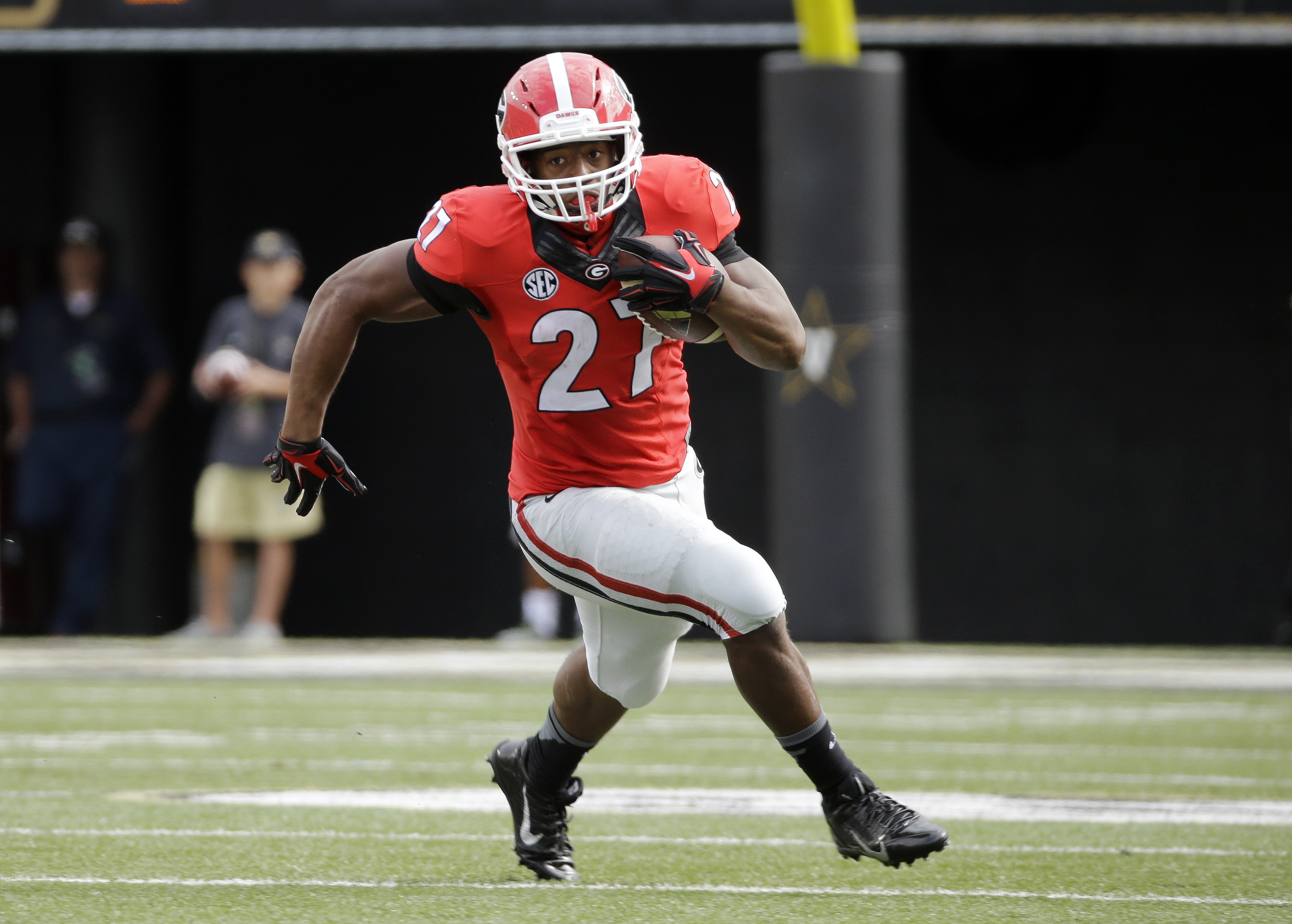 FILE - In this Sept. 12, 2015 file photo, Georgia running back Nick Chubb carries the ball against Vanderbilt in the first half of an NCAA college football game in Nashville, Tenn. No one player ever determines the fortunes of a team, although the quarter