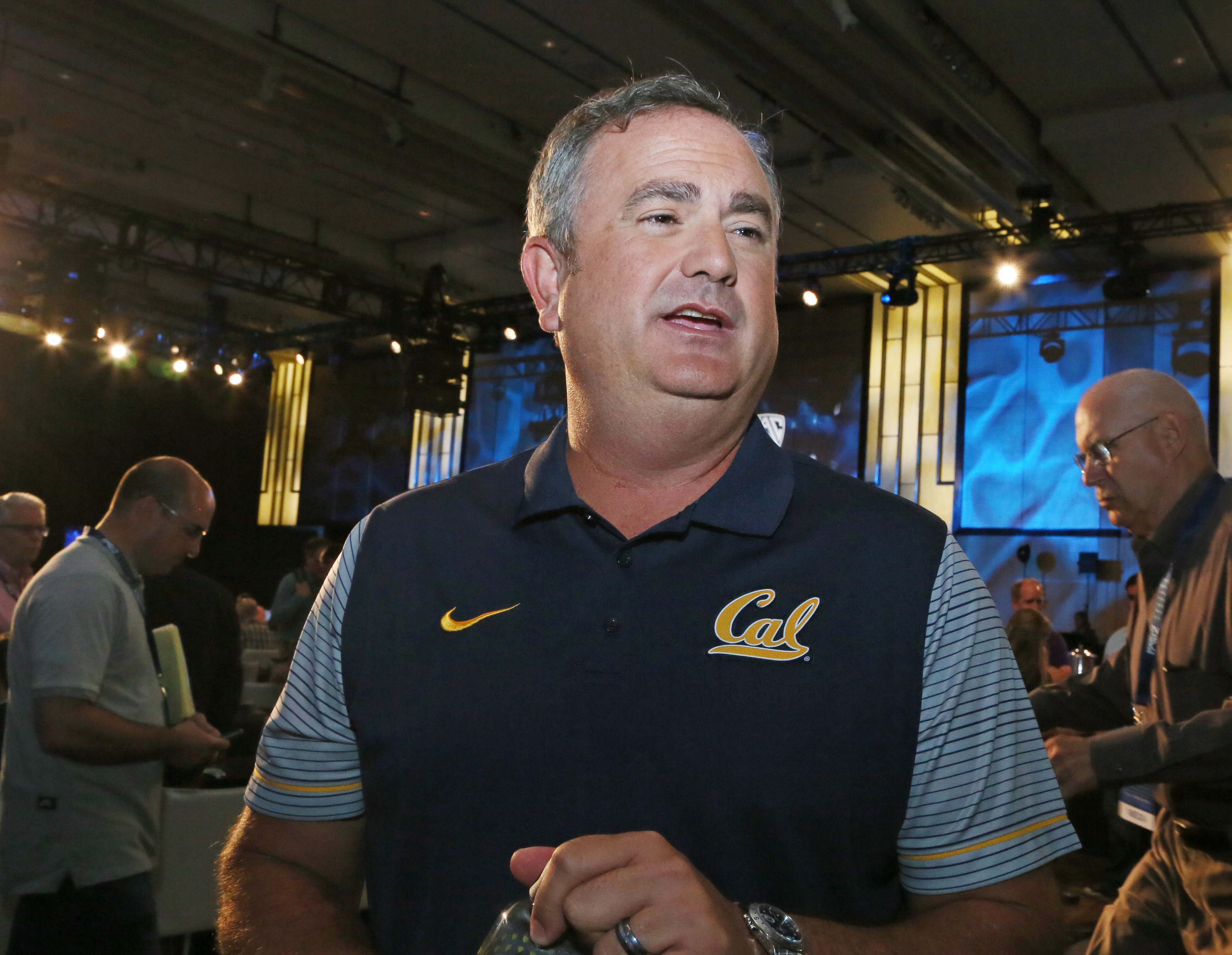 California head coach Sonny Dykes talks to reporters at the Pac-12 NCAA college football media day in Los Angeles Thursday, July 14, 2016. (AP Photo/Reed Saxon)