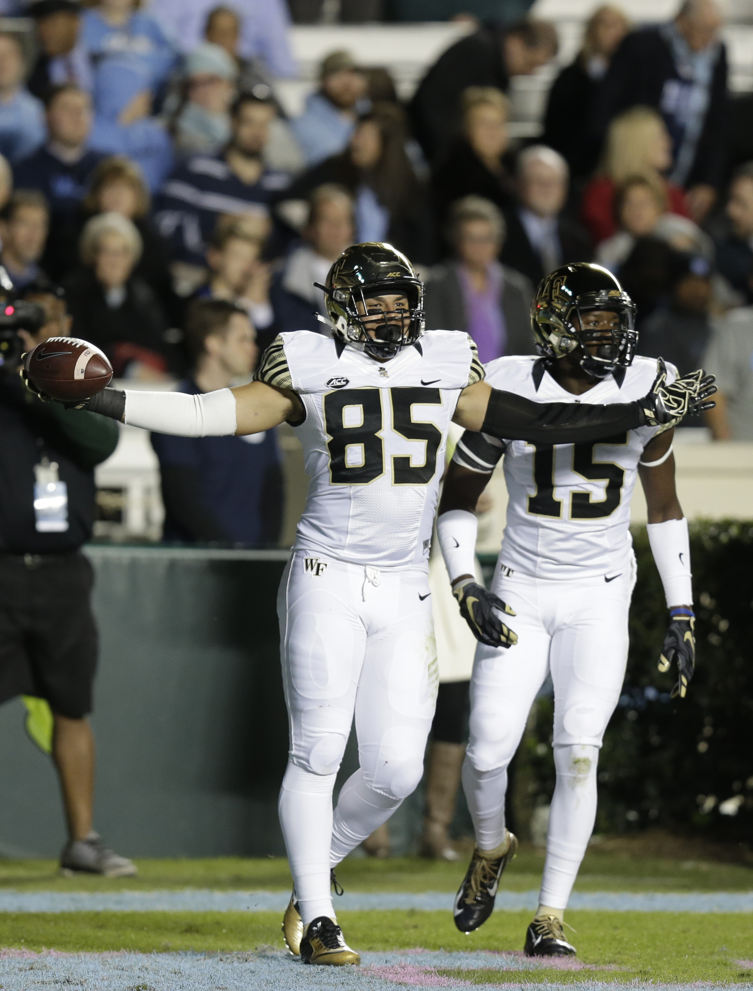 FILE - In this Oct. 17, 2015, file photo, Wake Forest's Cam Serigne (85) celebrates following his touchdown against North Carolina during the first half of an NCAA college football game in Chapel Hill, N.C. Serigne is tired of racking up empty stats at Wa