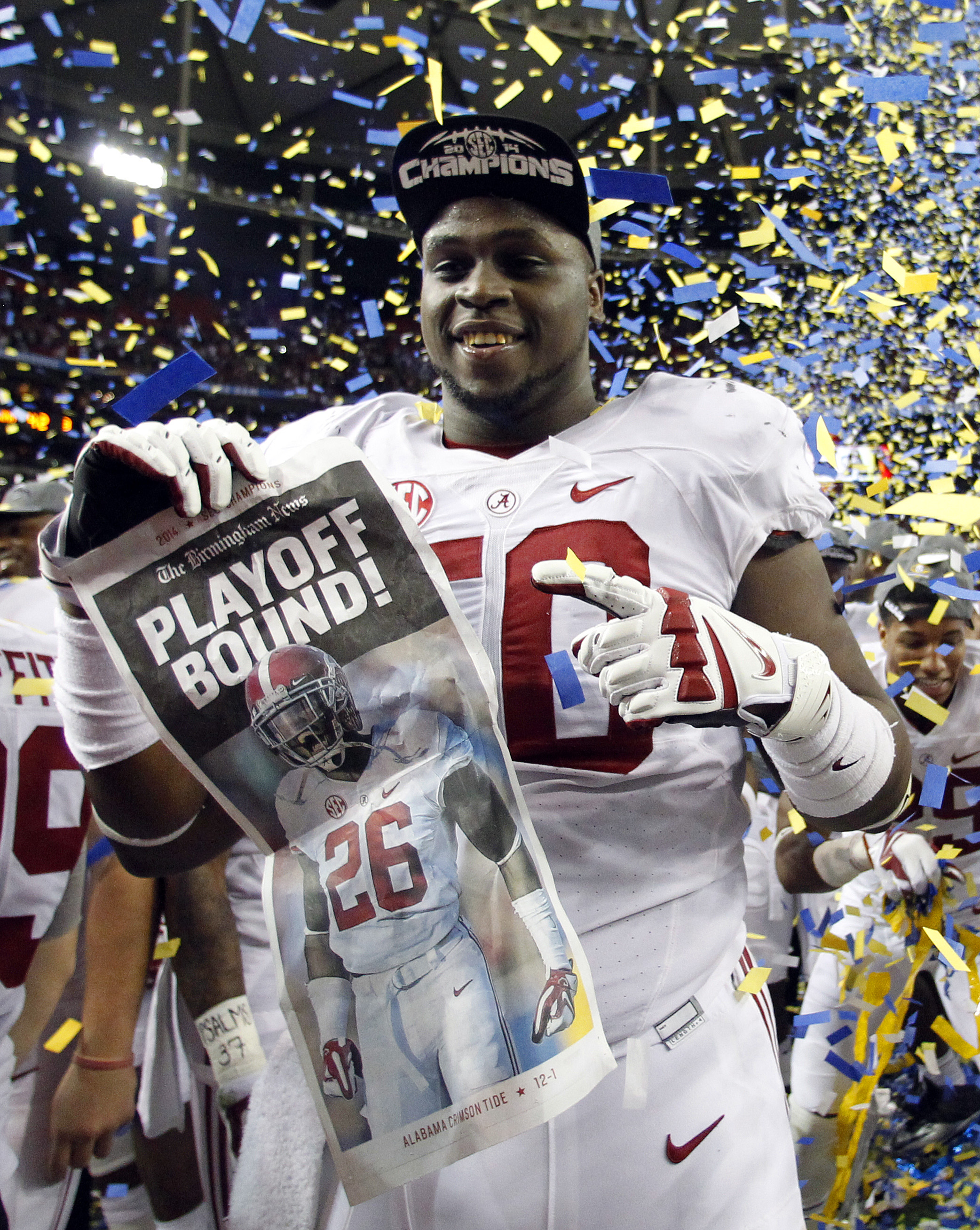 Alabama offensive lineman Alphonse Taylor (50) celebrates the win over Missouri in an NCAA college football game Saturday, Dec. 6, 2014, in Atlanta, Ga. (AP Photo/Butch Dill)