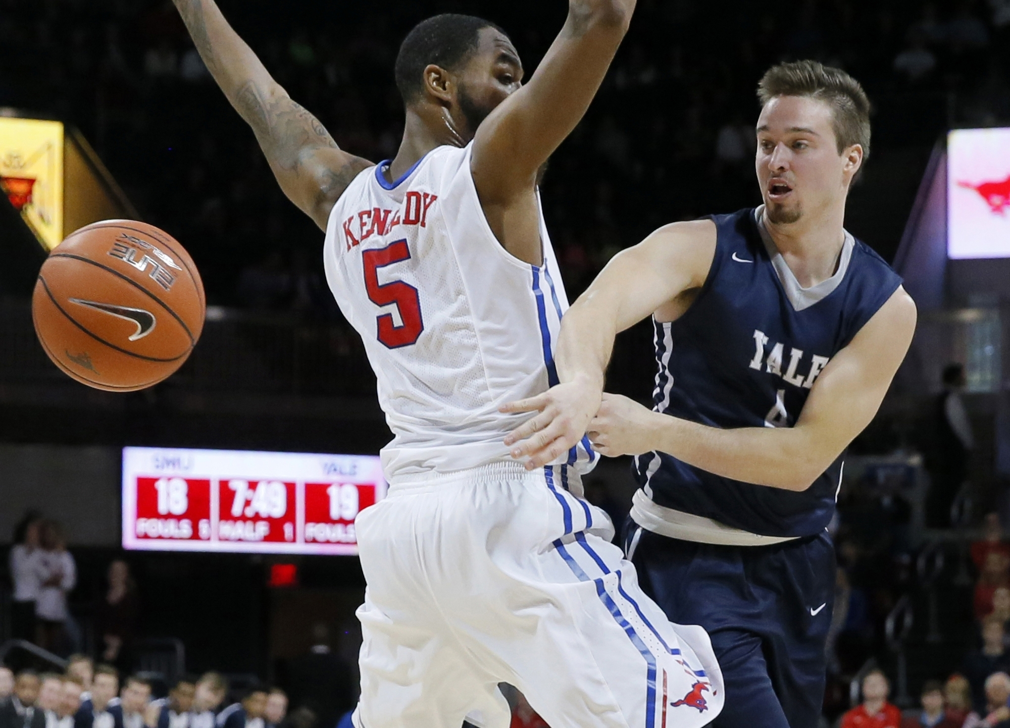 FILE - In this Nov. 22, 2015 FILE photo, Yale's Jack Montague, right, passes the ball around SMU's Markus Kennedy during an NCAA college basketball game in Dallas. Montague's attorney said he was expelled from Yale in Feb. 2016, because of a sexual assaul