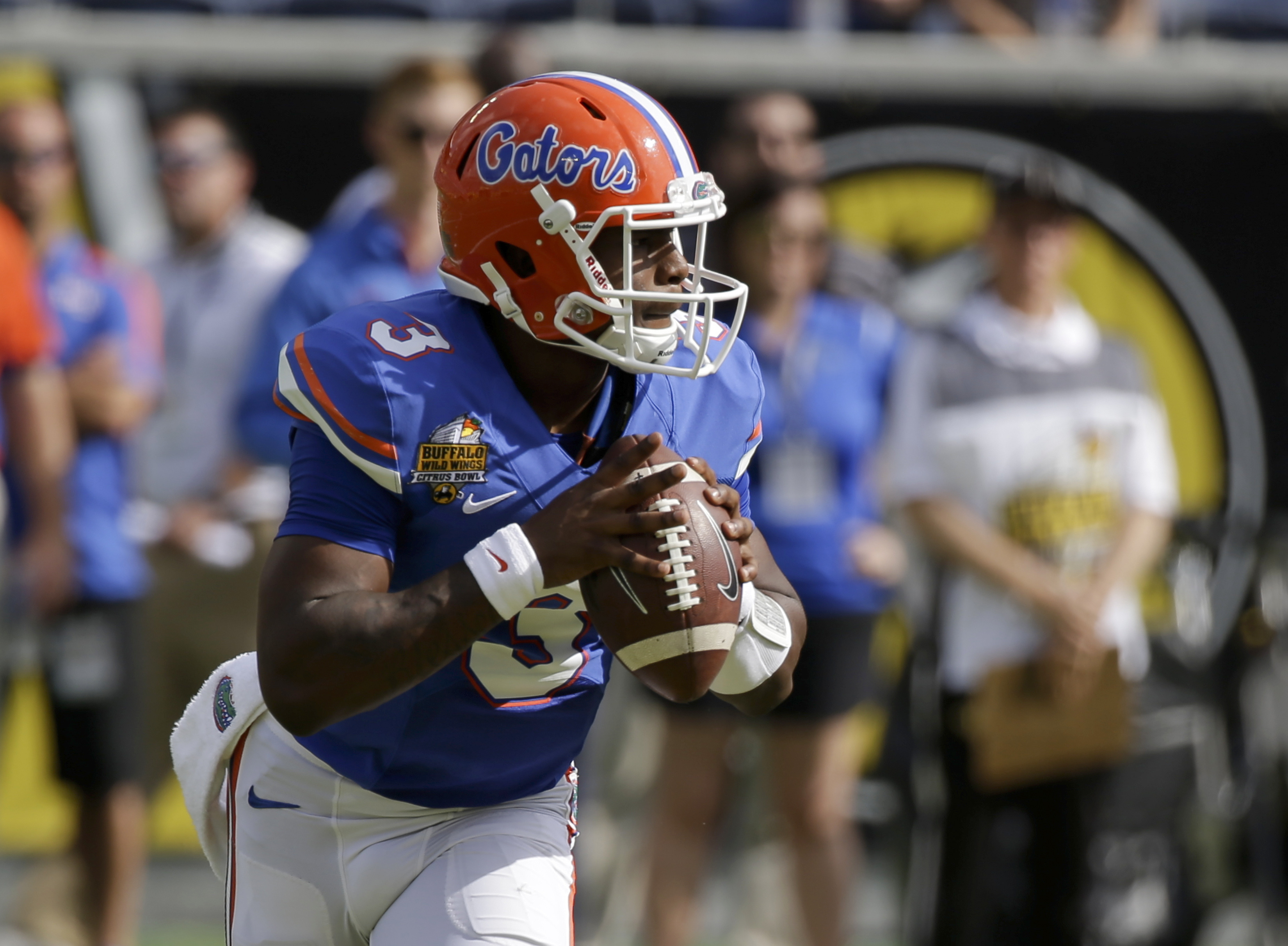 Florida quarterback Treon Harris (3) looks for a receiver against Michigan during the first half of the Citrus Bowl NCAA college football game, Friday, Jan. 1, 2016, in Orlando, Fla. (AP Photo/John Raoux)