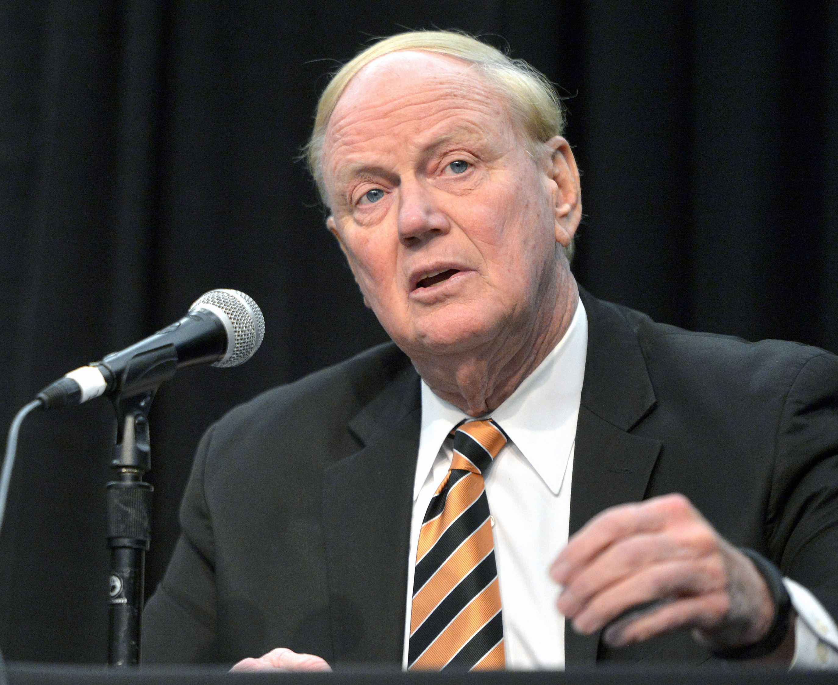 FILE - In this Feb. 5, 2016, file photo, University of Louisville President Dr. James Ramsey address the media in Louisville Ky. Louisville has announced additional self-imposed sanctions on its men's basketball program in the wake of an escort's allegati
