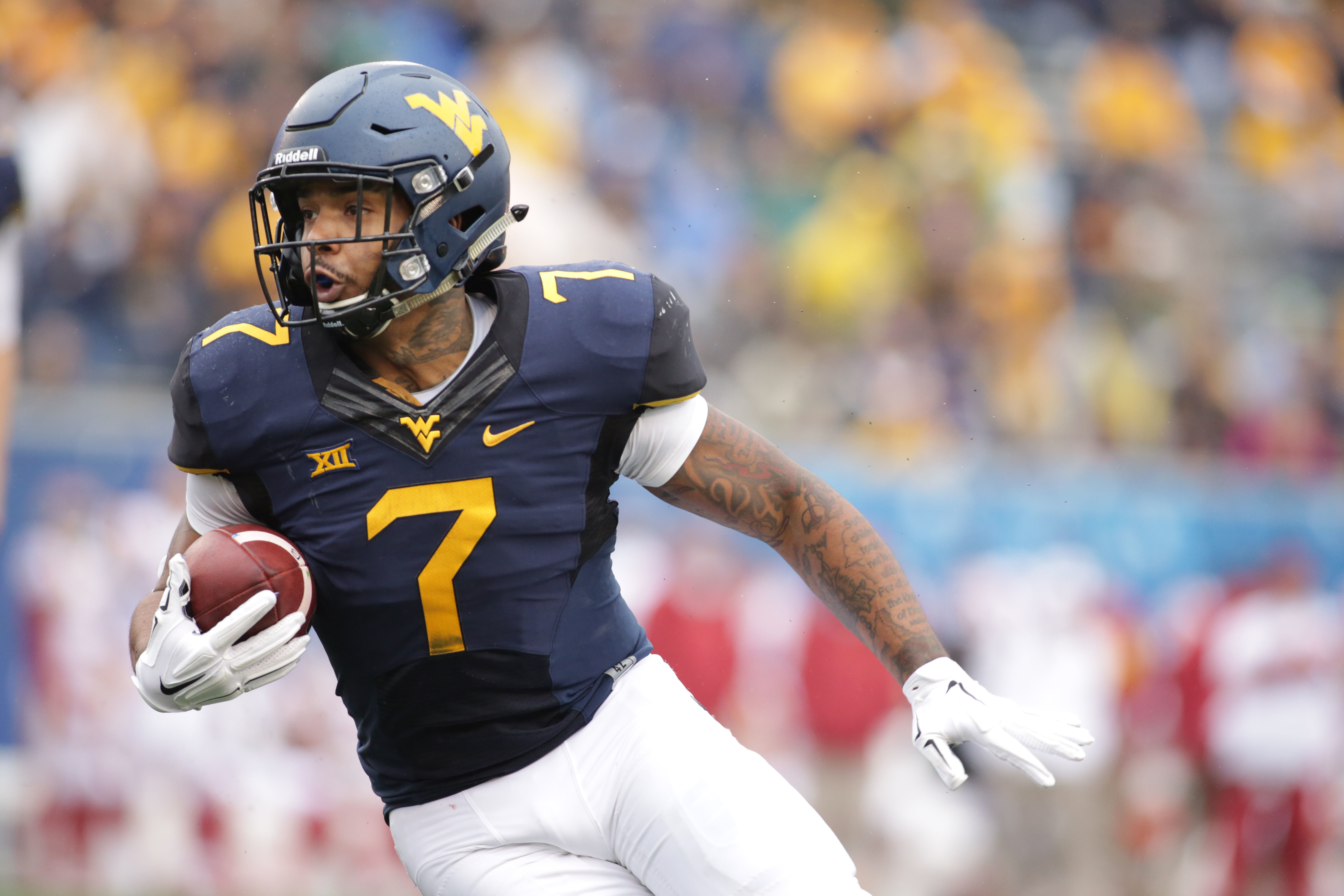 FILE - In this Nov. 28, 2015, file photo, West Virginia running back Rushel Shell carries during an NCAA college football game in Morgantown, W.Va. Shell is a bruiser at 220 pounds and a former four-star recruit. Hes been a good player for the Mountaineer