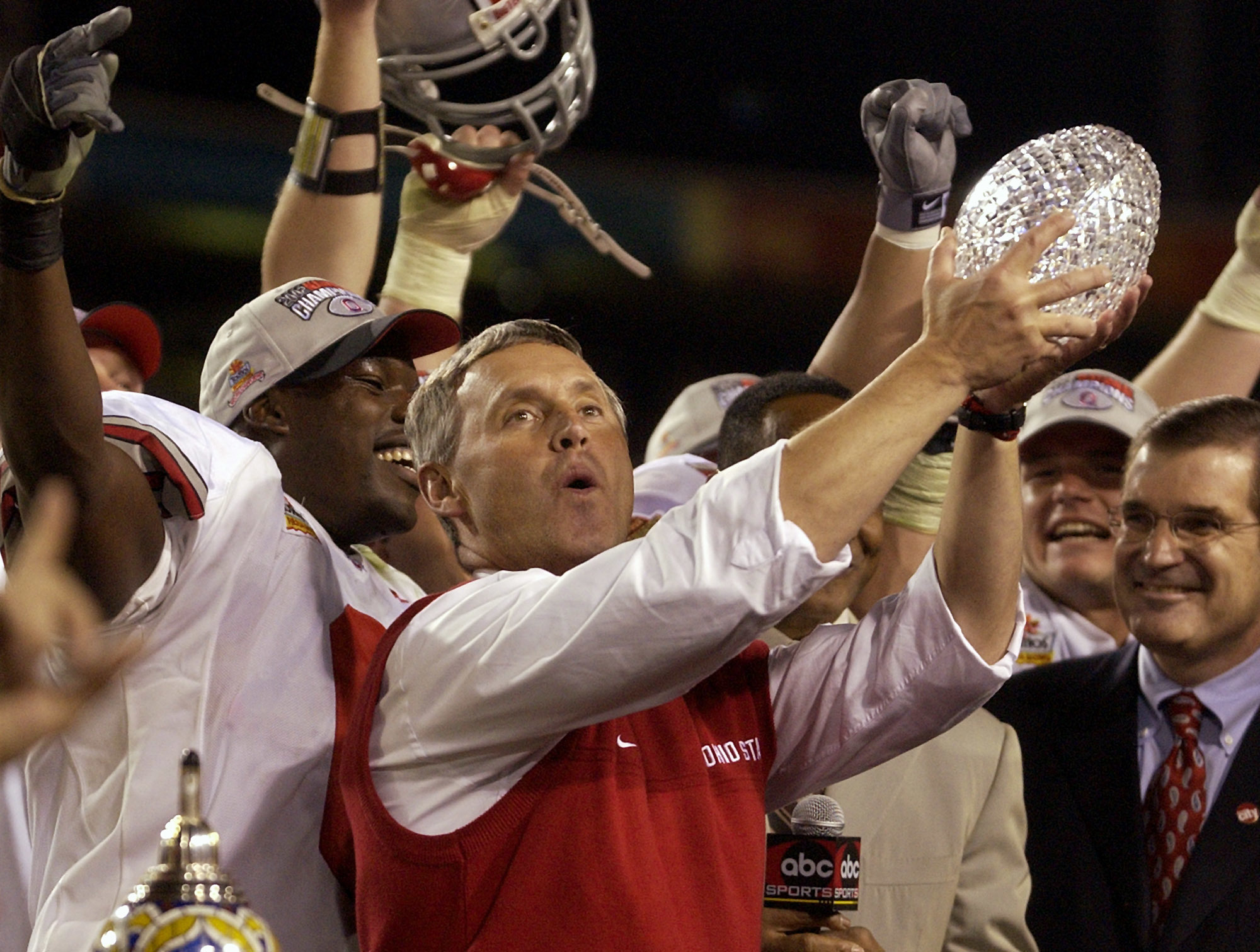 FILE - In this Jan. 3, 2003,  file photo, Ohio State coach Jim Tressel holds up the championship trophy after Ohio State beat Miami 31-24 in two overtimes in the Fiesta Bowl in Tempe, Ariz. The Associated Press has been ranking the best teams in college f