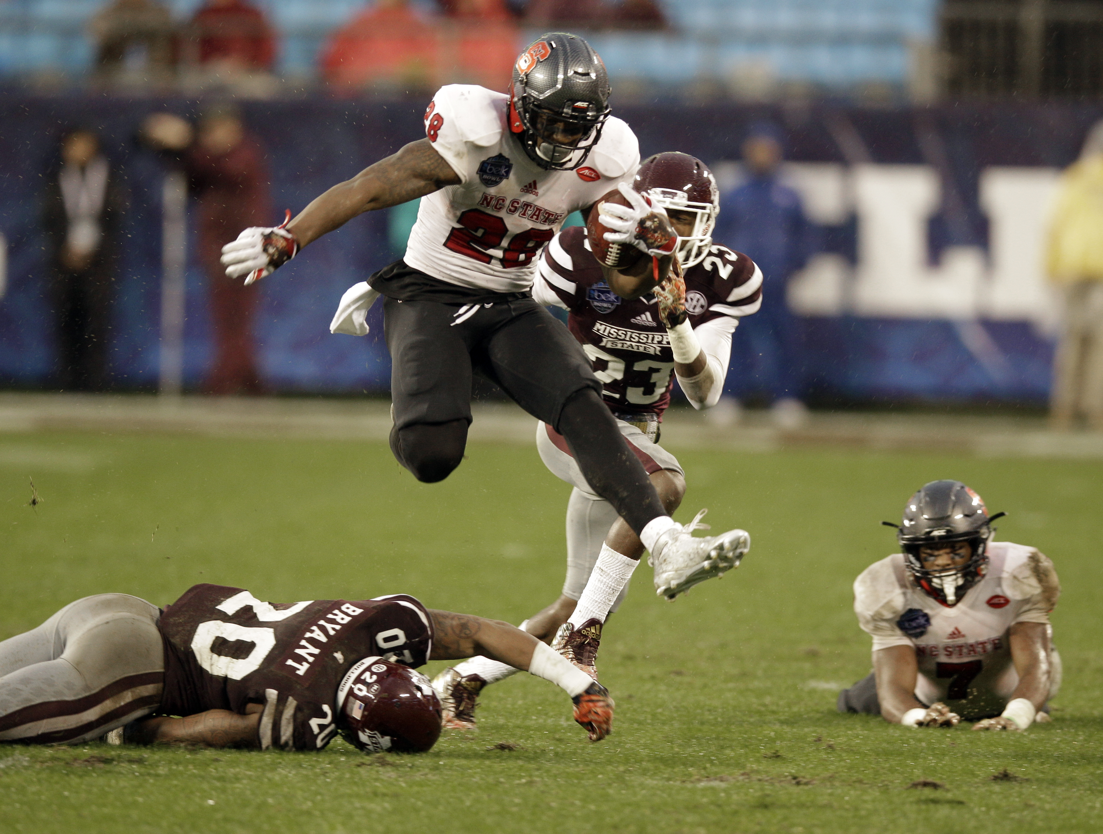 FILE - In this Dec. 30, 2015, file photo, North Carolina State tight end Jaylen Samuels (28) runs for a touchdown against Mississippi State in the first half of the Belk Bowl NCAA college football game, in Charlotte, N.C. Wolfpack offensive coordinator El