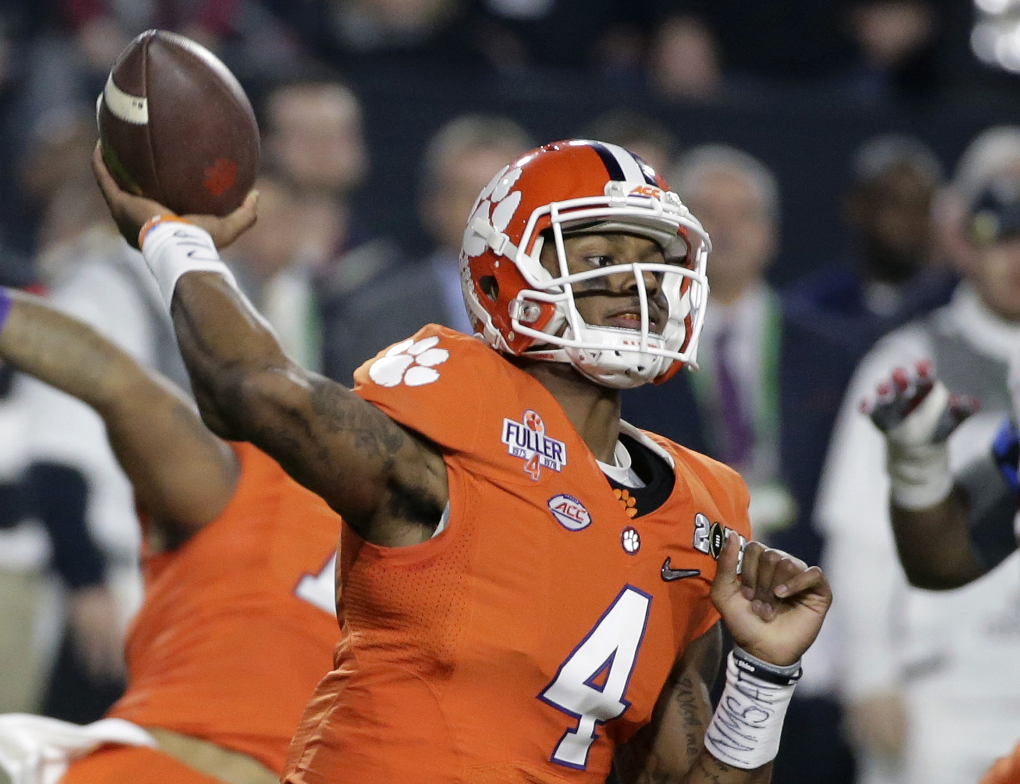 FILE - In this Jan. 11, 2016, file photo, Clemson quarterback Deshaun Watson throws during the first half of the NCAA college football playoff championship game against Alabama, in Glendale, Ariz. Watson is the favorite to win the Heisman Trophy and the l