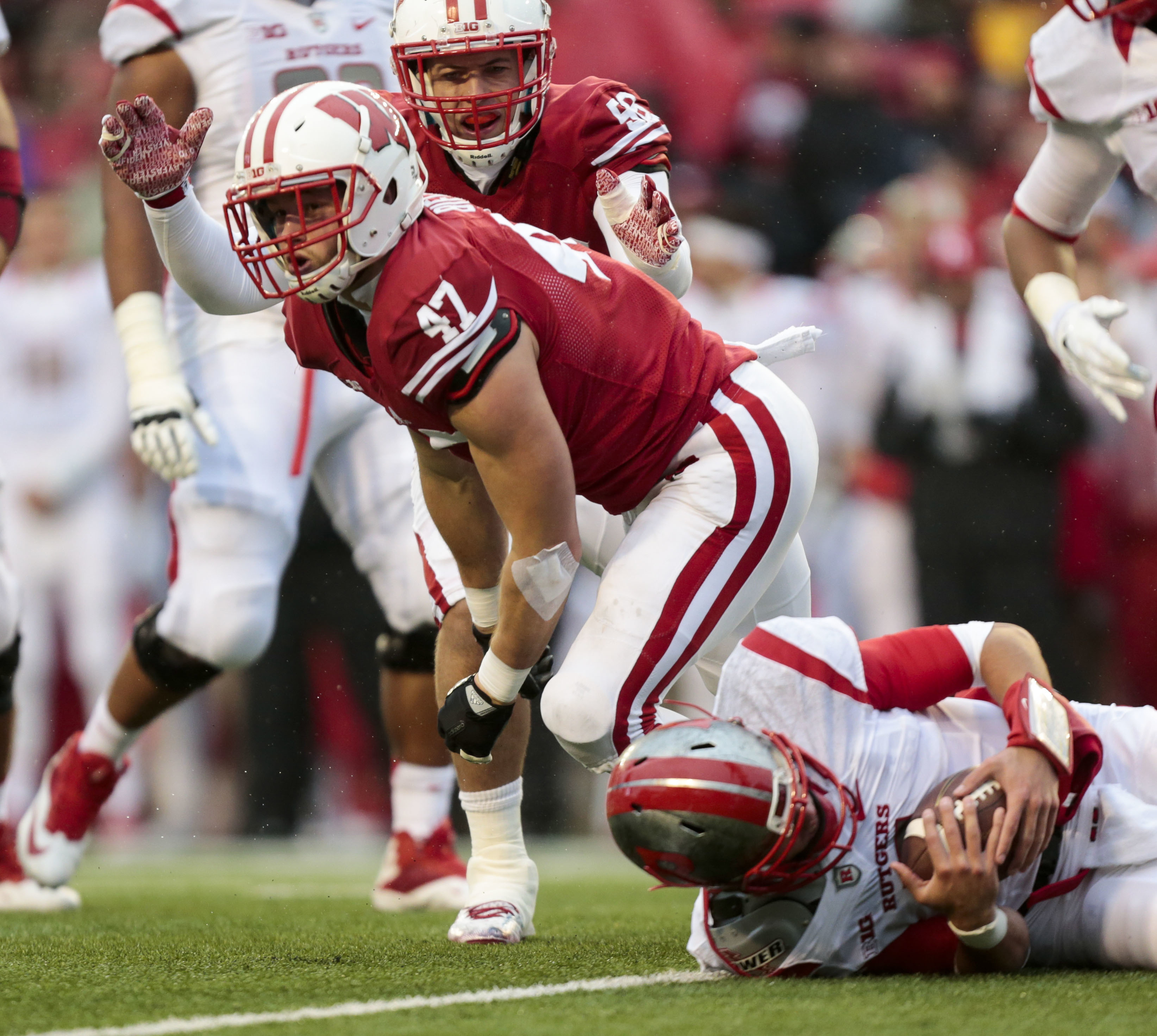 FILE - In this Oct. 31, 2015, file photo, Wisconsin linebacker Vince Biegel (47) and Joe Schobert celebrate after Biegel sacked Rutgers quarterback Chris Laviano during an NCAA college football game in Madison, Wis. Biegel was one of the best linebackers