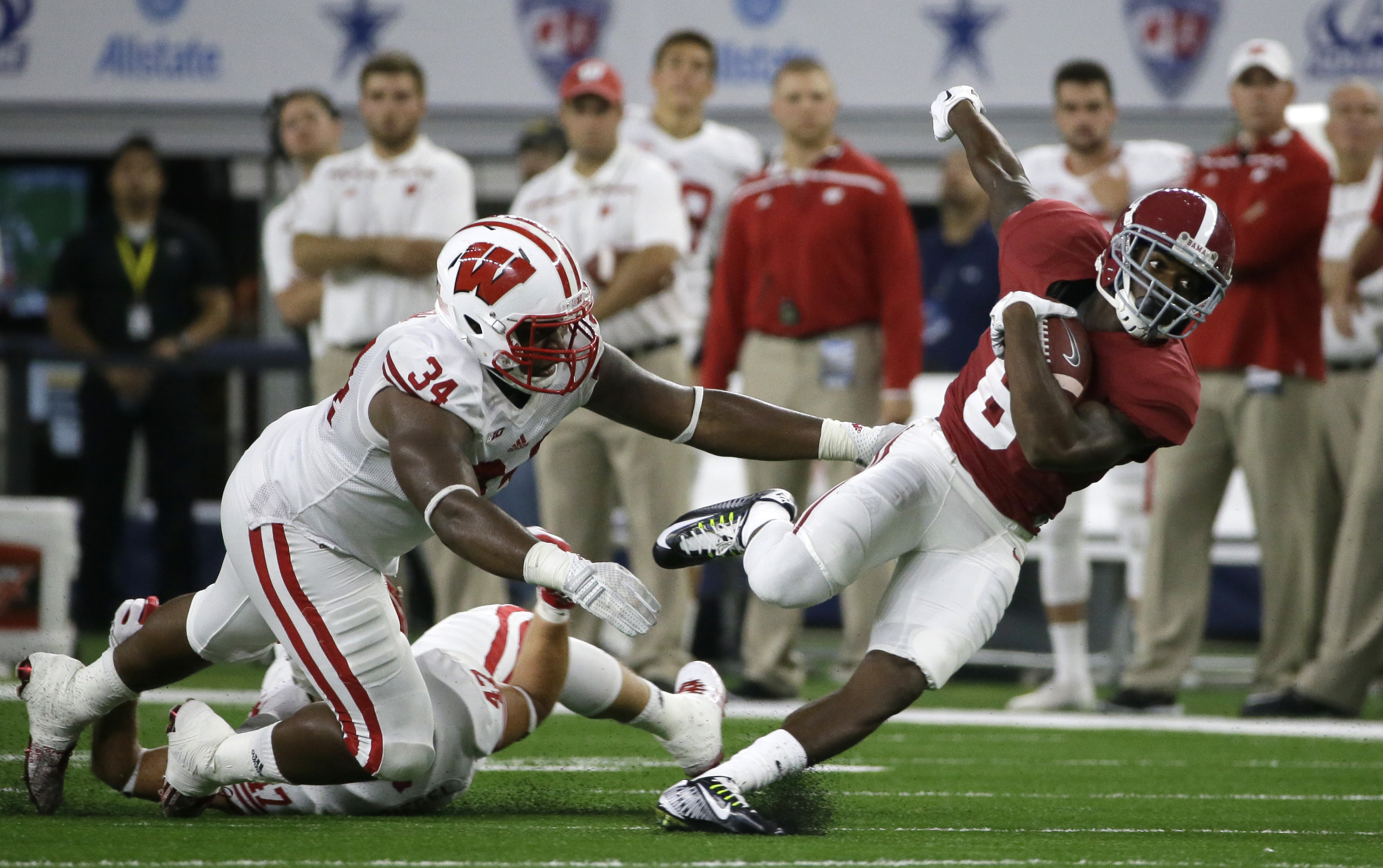 FILE - In this Sept. 5, 2015, file photo, Alabama wide receiver Robert Foster (8) catches a pass against Wisconsin defensive end Chikwe Obasih (34) and linebacker Vince Biegel (47) during the first half of an NCAA college football game, in Arlington, Texa