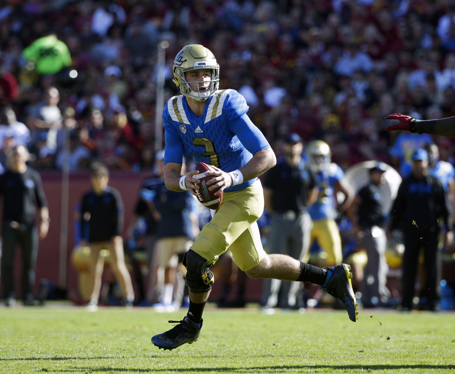 FILE - In this Nov. 28, 2015, file photo, UCLA quarterback Josh Rosen looks for a receiver during the first half of an NCAA college football game against Southern California, in Los Angeles. A new offensive scheme should mean bigger plays and more chances