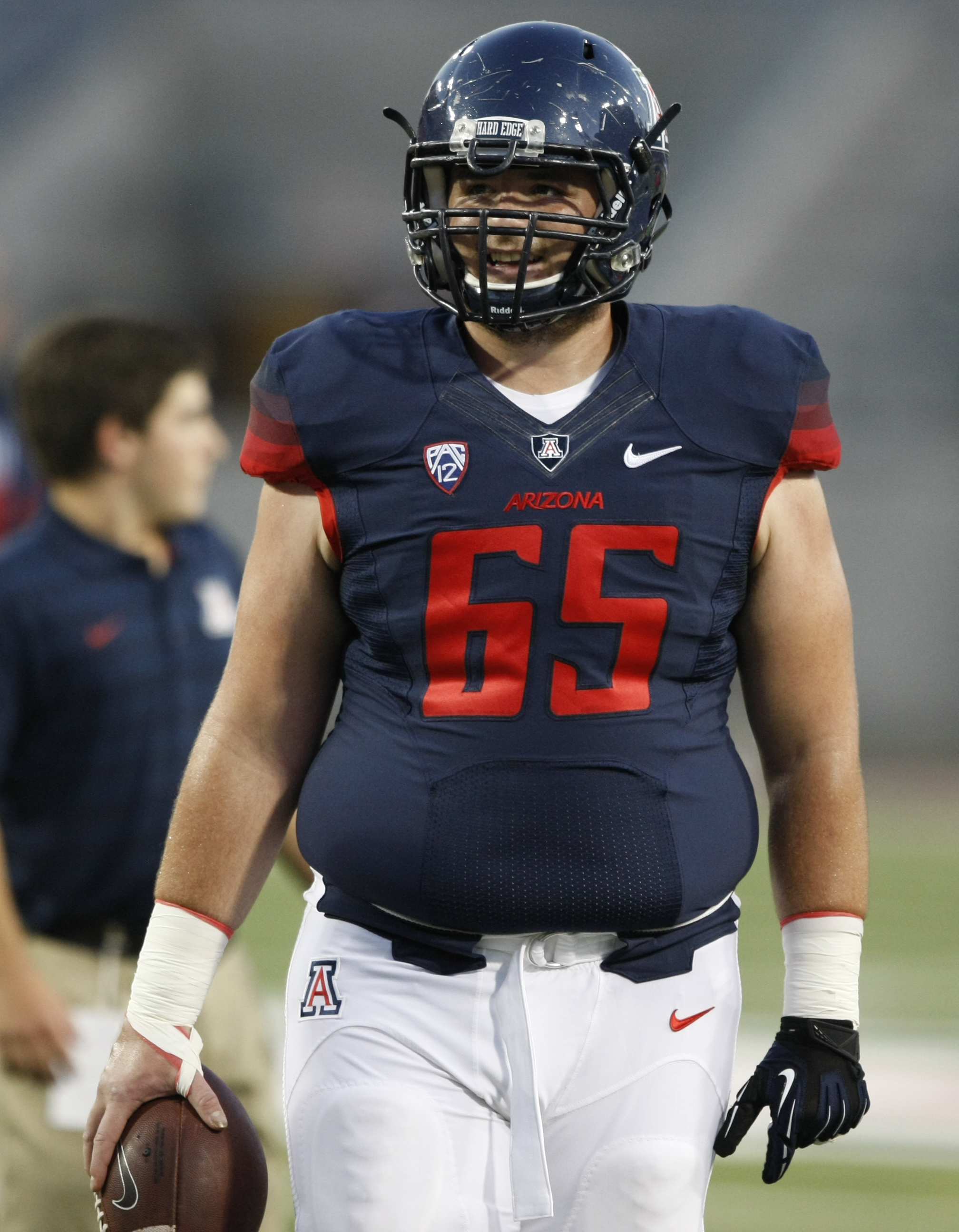 Arizona offensive linesman Zach Hemmila (65) against UNLV during the first half of the NCAA college football game, Friday, Aug. 29, 2014, in Tucson, Ariz. (AP Photo/Rick Scuteri)