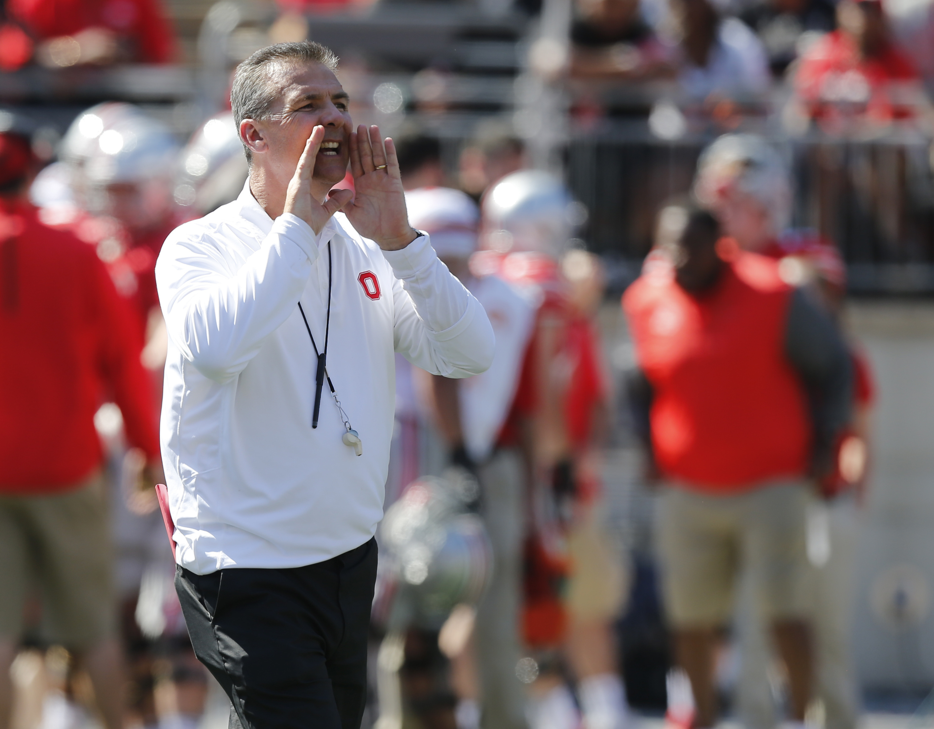 FILE - In this April 16, 2016, file photo, Ohio State head coach Urban Meyer shouts to his team during Ohio State's NCAA college football spring game, in Columbus, Ohio. Meyer has a bevy of talented reinforcements ready to step to the fore after the NFL p