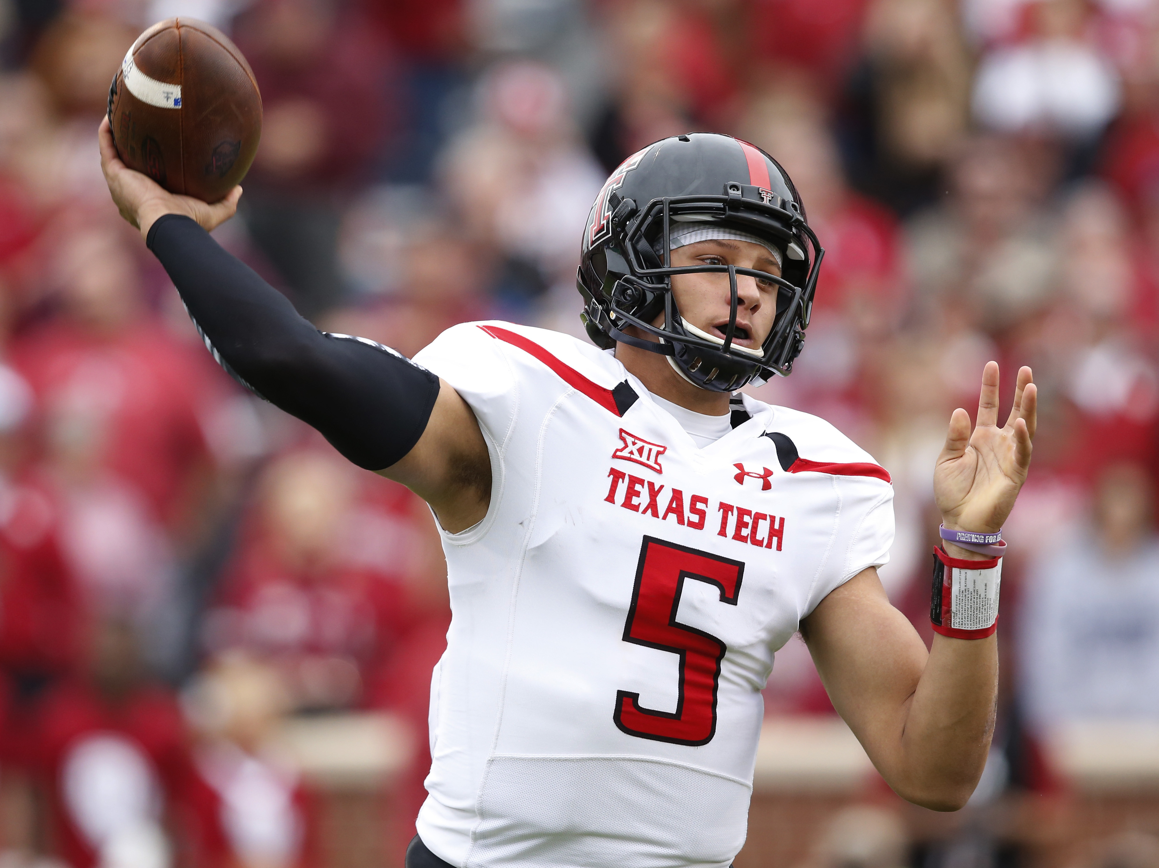 FILE - In this Oct. 24, 2015, file photo, Texas Tech quarterback Patrick Mahomes (5) passes in the first quarter of an NCAA college football game against Oklahoma in Norman, Okla. Texas Techs success this year rests on the shoulders of its junior QB. Last