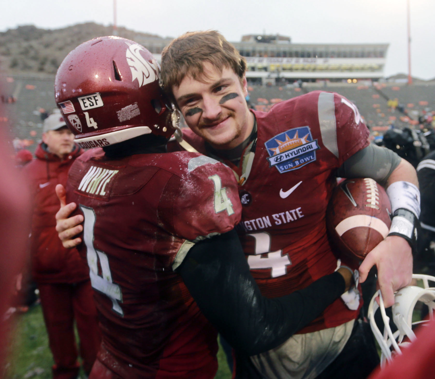 FILE -- In this Dec. 26, 2015, file photo, Washington State quarterback and game MVP Luke Falk, right, receives congratulations at the conclusion of the Sun Bowl NCAA college football game against Miami in El Paso, Texas. (AP Photo/Victor Calzada, File)