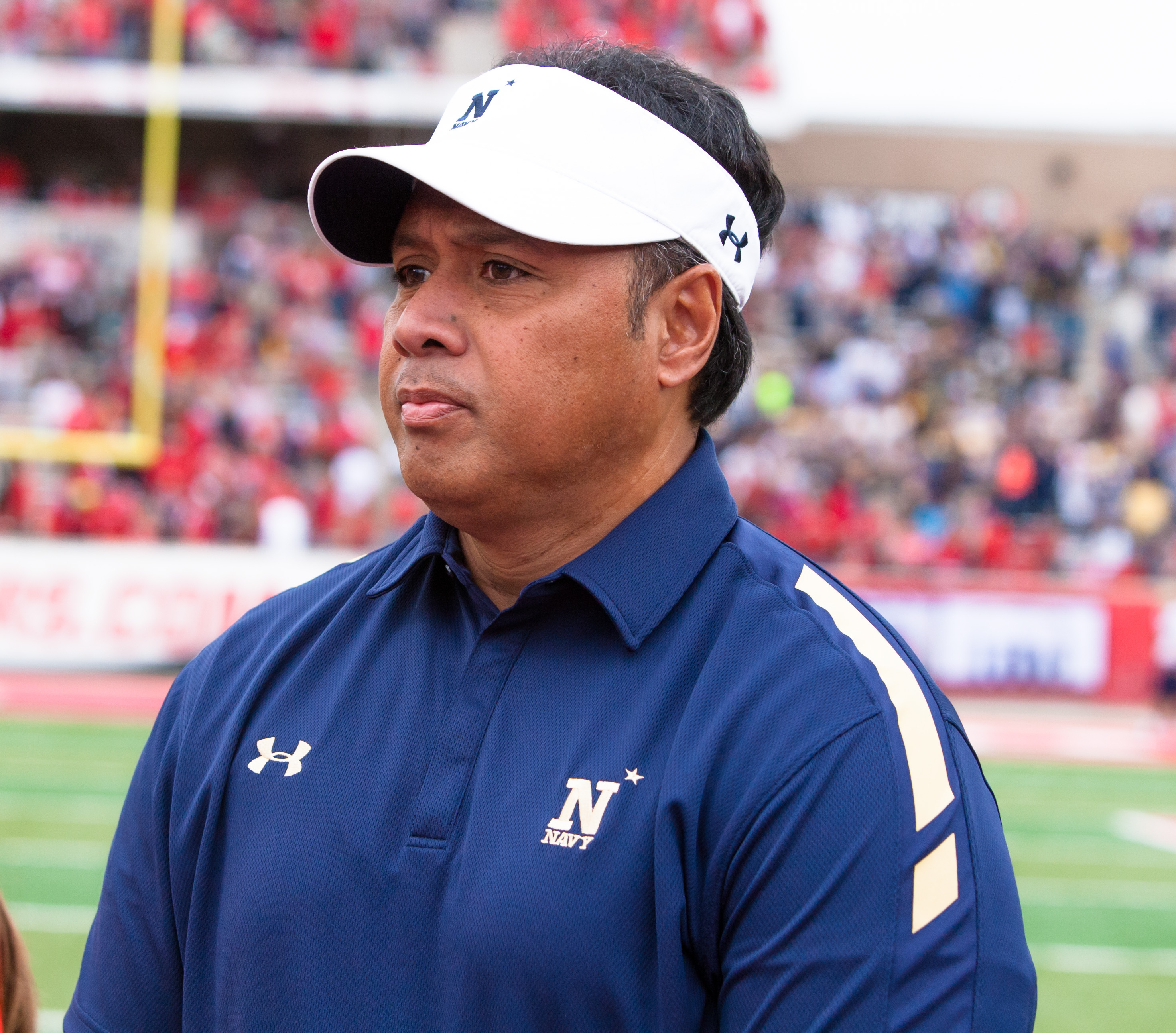 FILE - This Nov. 27, 2015, file photo shows Navy's head coach Ken Niumatalolo on the field for the coin toss before an NCAA college football game between Houston and Navy in Houston, Texas. To no ones surprise, the very first question asked of Niumatalolo