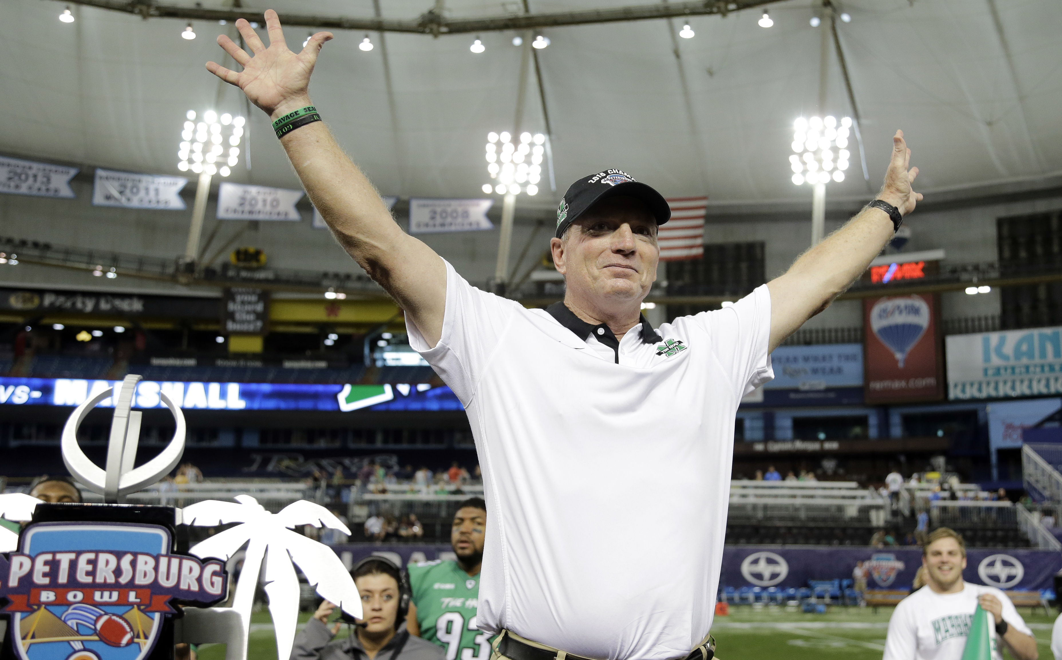 FILE - In this Dec. 26, 2015, file photo, Marshall head coach Doc Holliday celebrates the team's 16-10 win against Connecticut in the St. Petersburg Bowl NCAA college football game in St. Petersburg, Fla. Marshall has never had four consecutive 10-win sea
