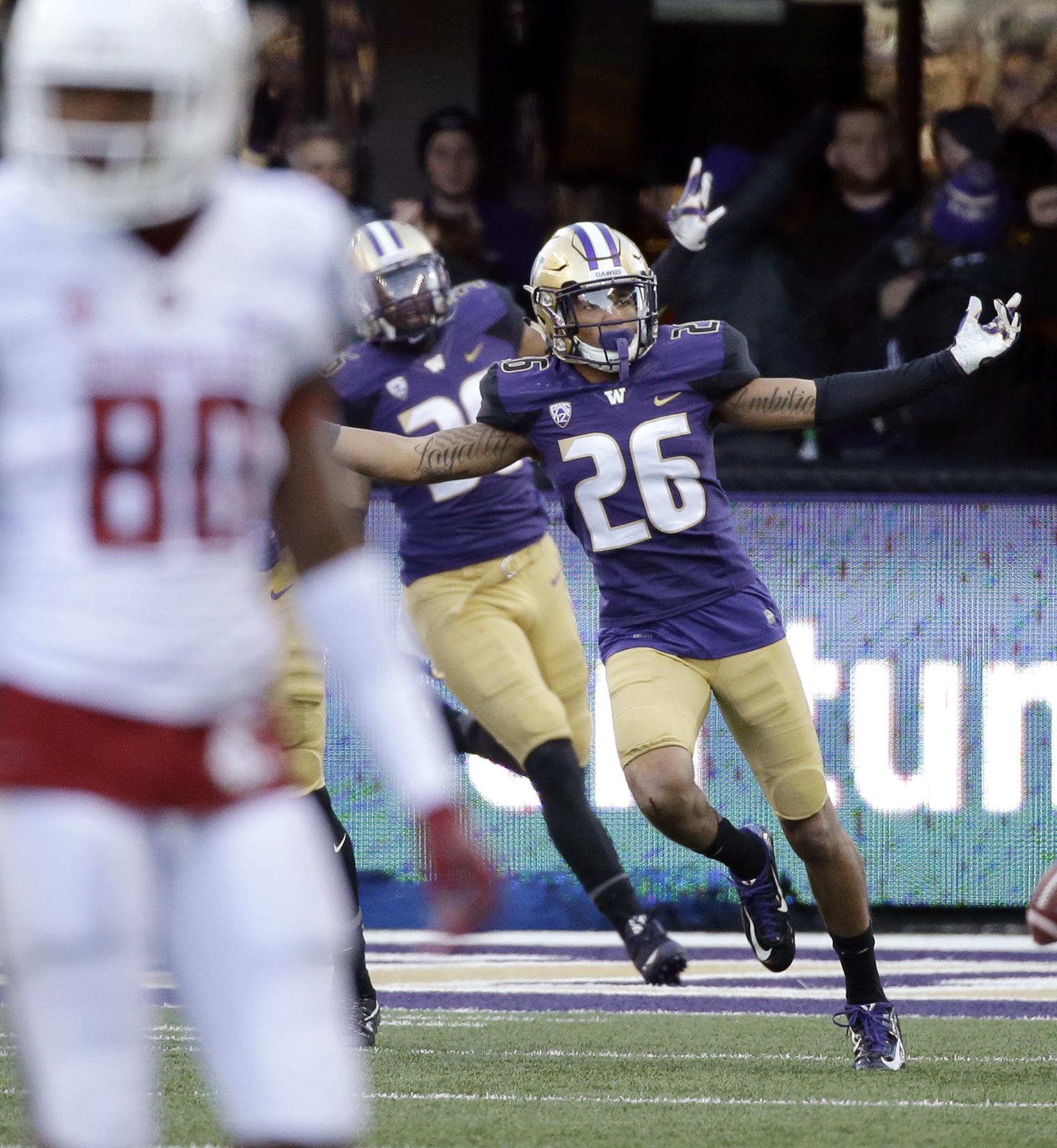 FILE -- In this Nov. 27, 2015, file photo, Washington's Sidney Jones celebrates scoring a touchdown on an interception against Washington State in an NCAA college football game in Seattle. (AP Photo/Elaine Thompson, File)