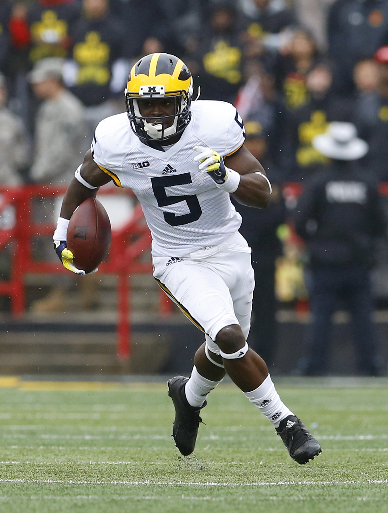 FILE- In this Oct. 3, 2015, file photo, Michigan's Jabrill Peppers carries the ball on a punt return in the first half of an NCAA college football game against Maryland, in College Park, Md. The pool of candidates for the Heisman Trophy is deep. Stanford'