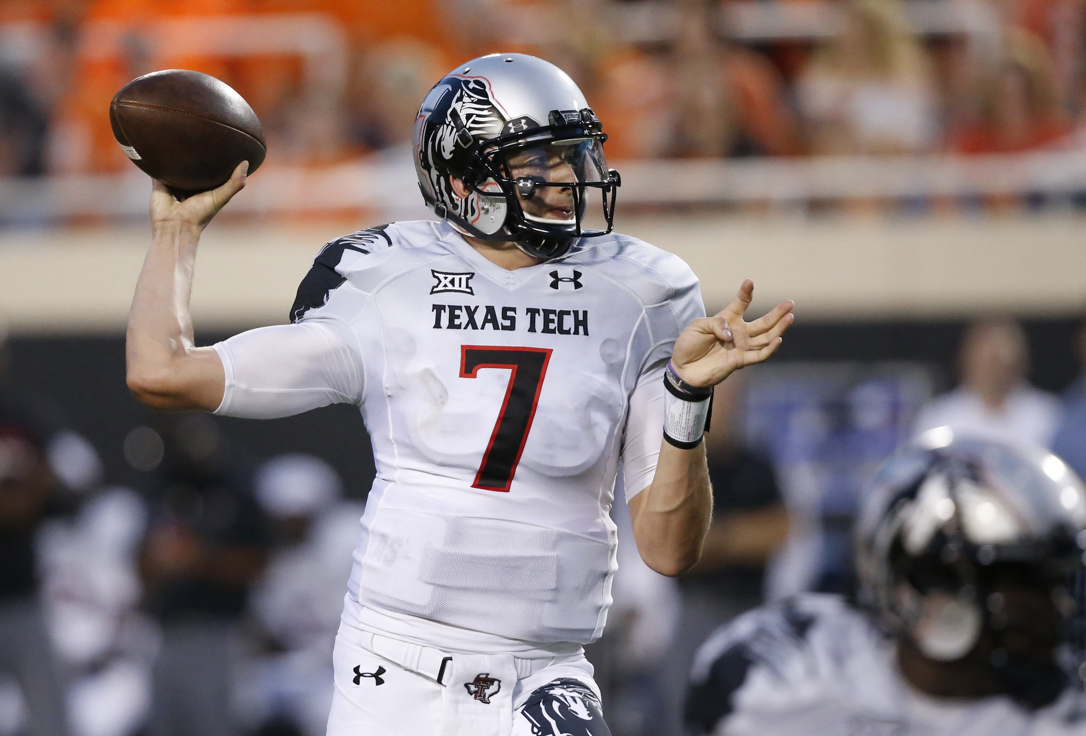 In this Sept. 25, 2014 photo, former Texas Tech quarterback Davis Webb (7) is pictured during an NCAA college football game between Texas Tech and Oklahoma State in Stillwater, Okla. Webb, a graduate transfer, has been named the starting quarterback for C