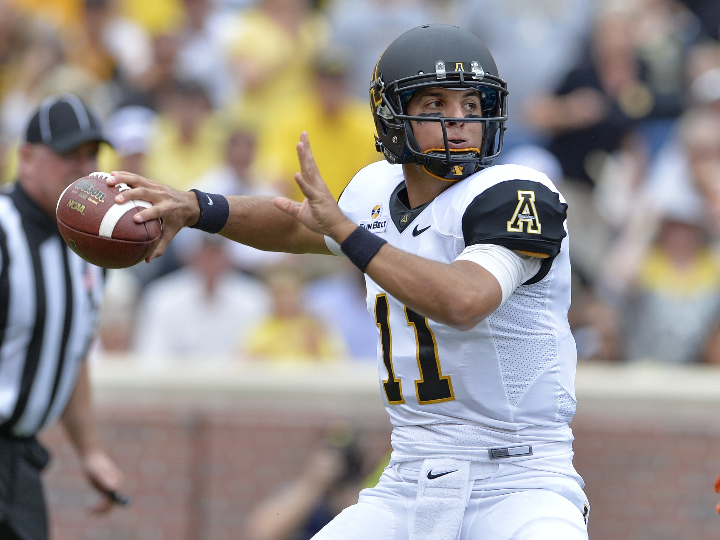FILE - In this Sept. 12, 2015, file photo, Appalachian State quarterback Taylor Lamb throws a pass during the first half of an NCAA college football game against Clemson, in Clemson, S.C. (AP Photo/Richard Shiro, File)